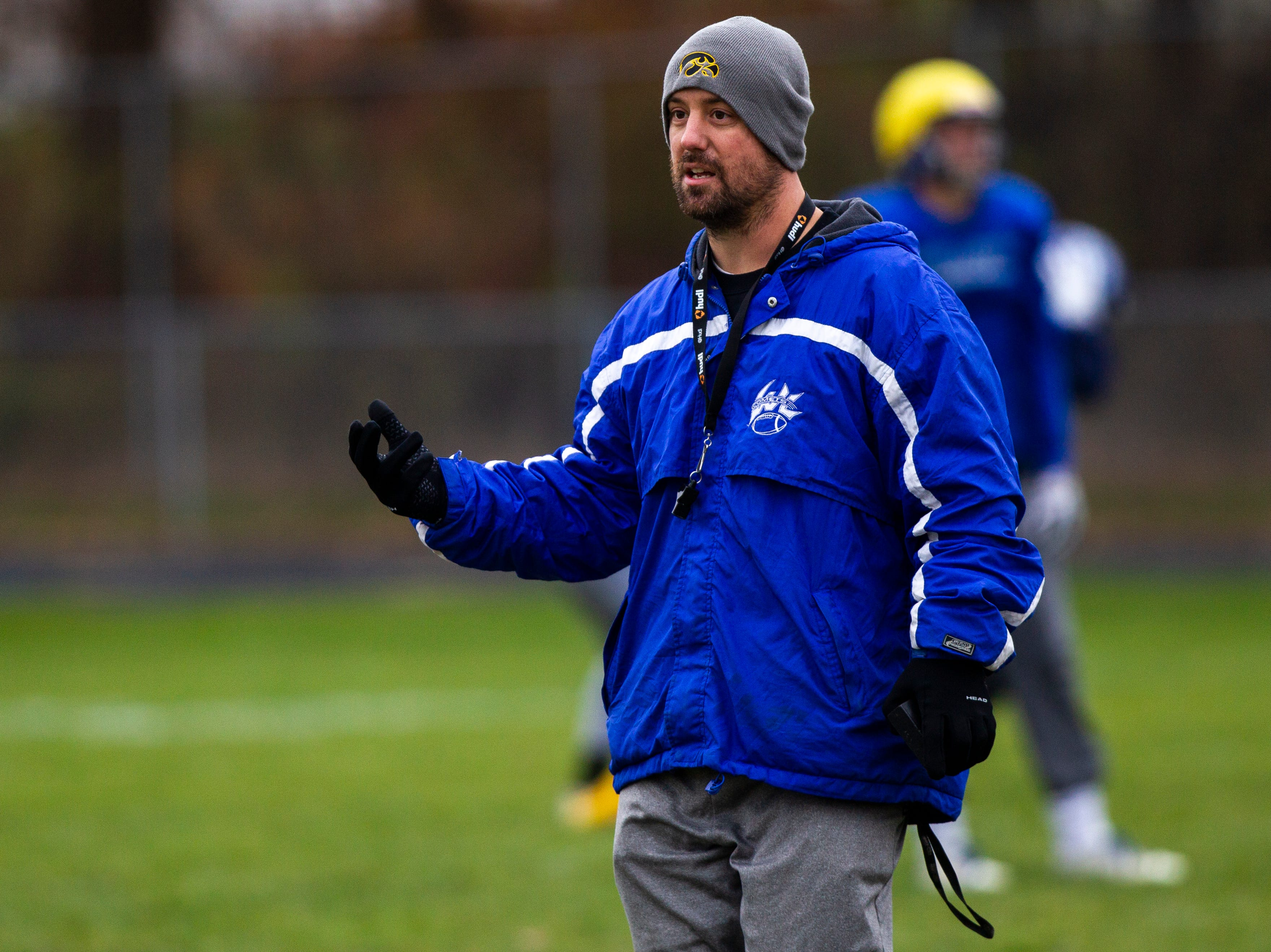 West Liberty head coach Jason Iske calls out to players during a football practice on Thursday, Nov. 8, 2018, at Memorial Field in West Liberty.