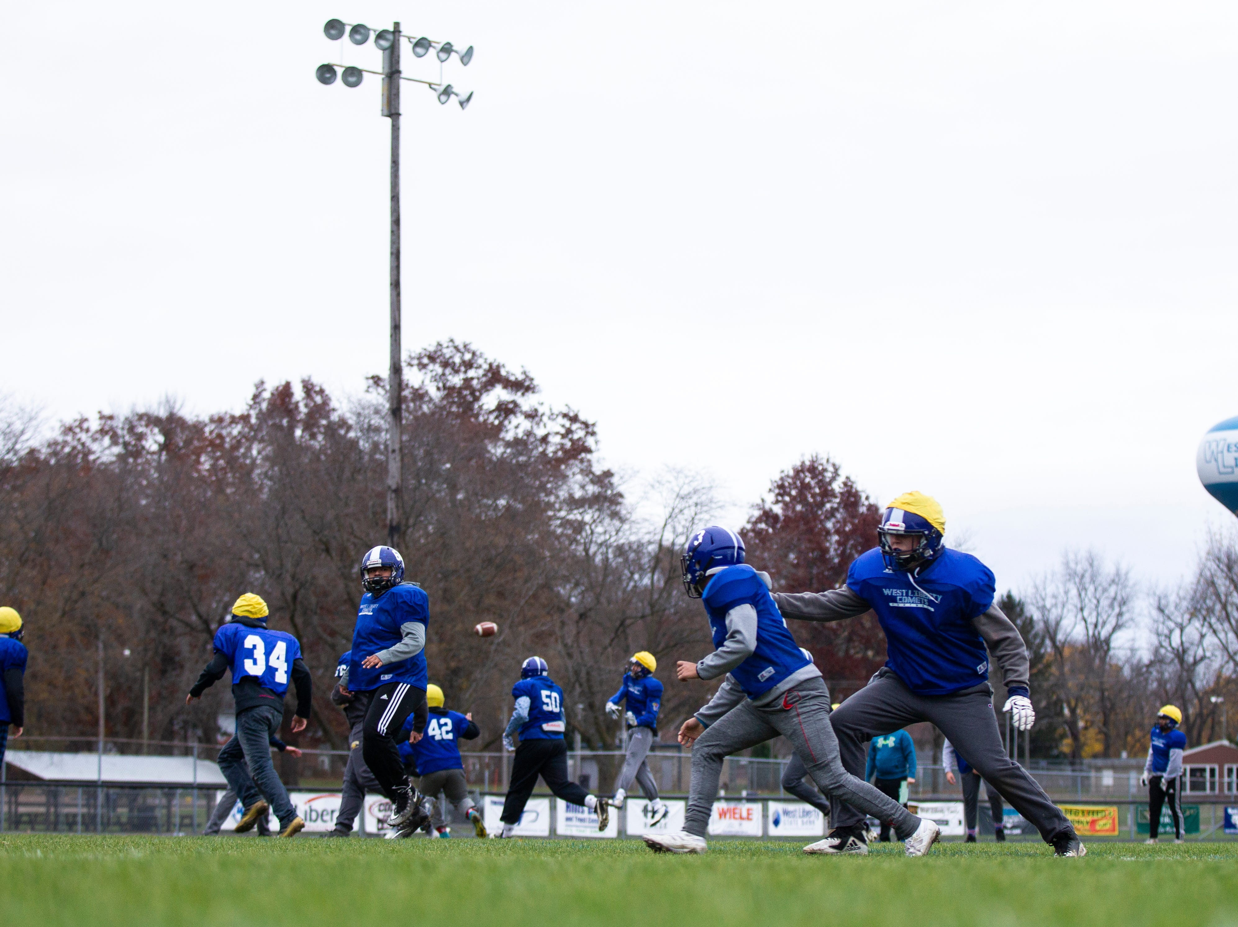 West Liberty players run a drill during football practice on Thursday, Nov. 8, 2018, at Memorial Field in West Liberty.