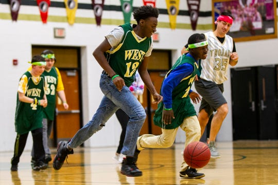 Iowa City West's Quintin Jones and Byamungu Omari take the ball up court during a basketball game on Thursday, Nov. 1, 2018, at West High School in Iowa City.