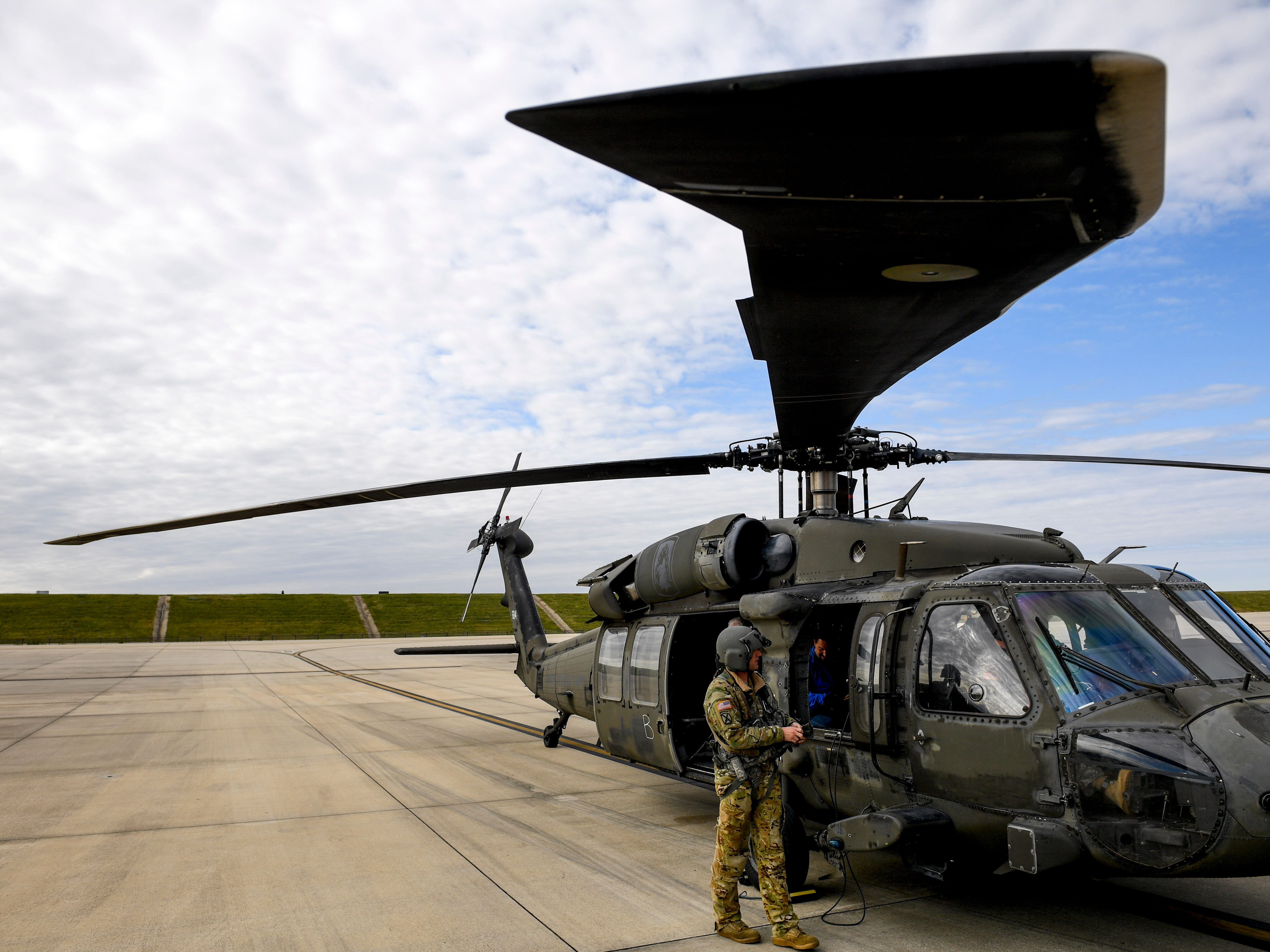 A National Guardsmen prepares their Black Hawk helicopter for a flight during the annual Bosslift event put on by Employer Support of the Guard and Reserve (ESGR) and the Tennessee National Guard at 164th Airlift Wing in Memphis, Tenn., on Thursday, Nov. 8, 2018.