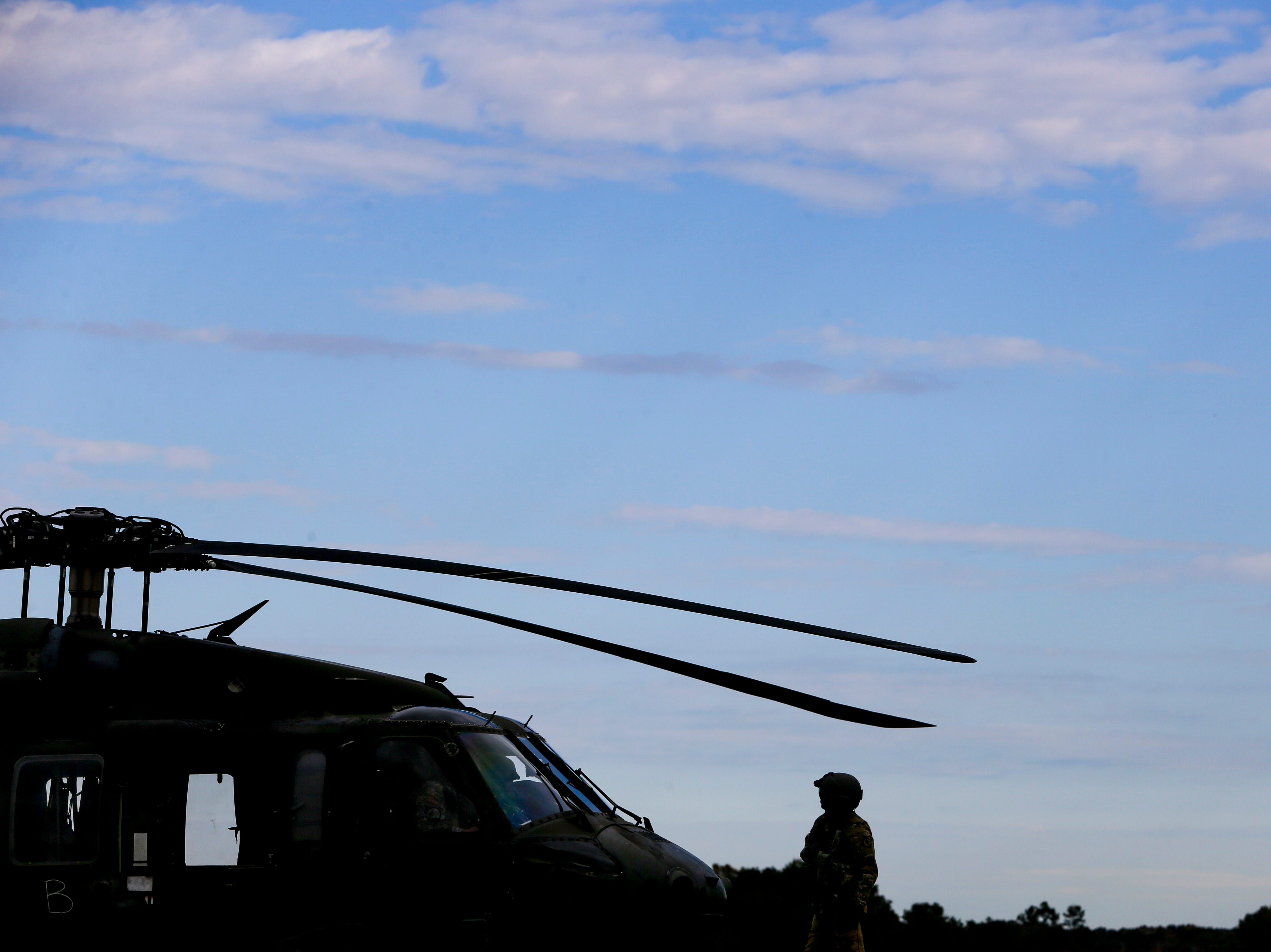 National Guardsmen do preparation with their Black Hawk helicopter before a flight during the annual Bosslift event put on by Employer Support of the Guard and Reserve (ESGR) and the Tennessee National Guard at Army Aviation Facility in Jackson, Tenn., on Thursday, Nov. 8, 2018.