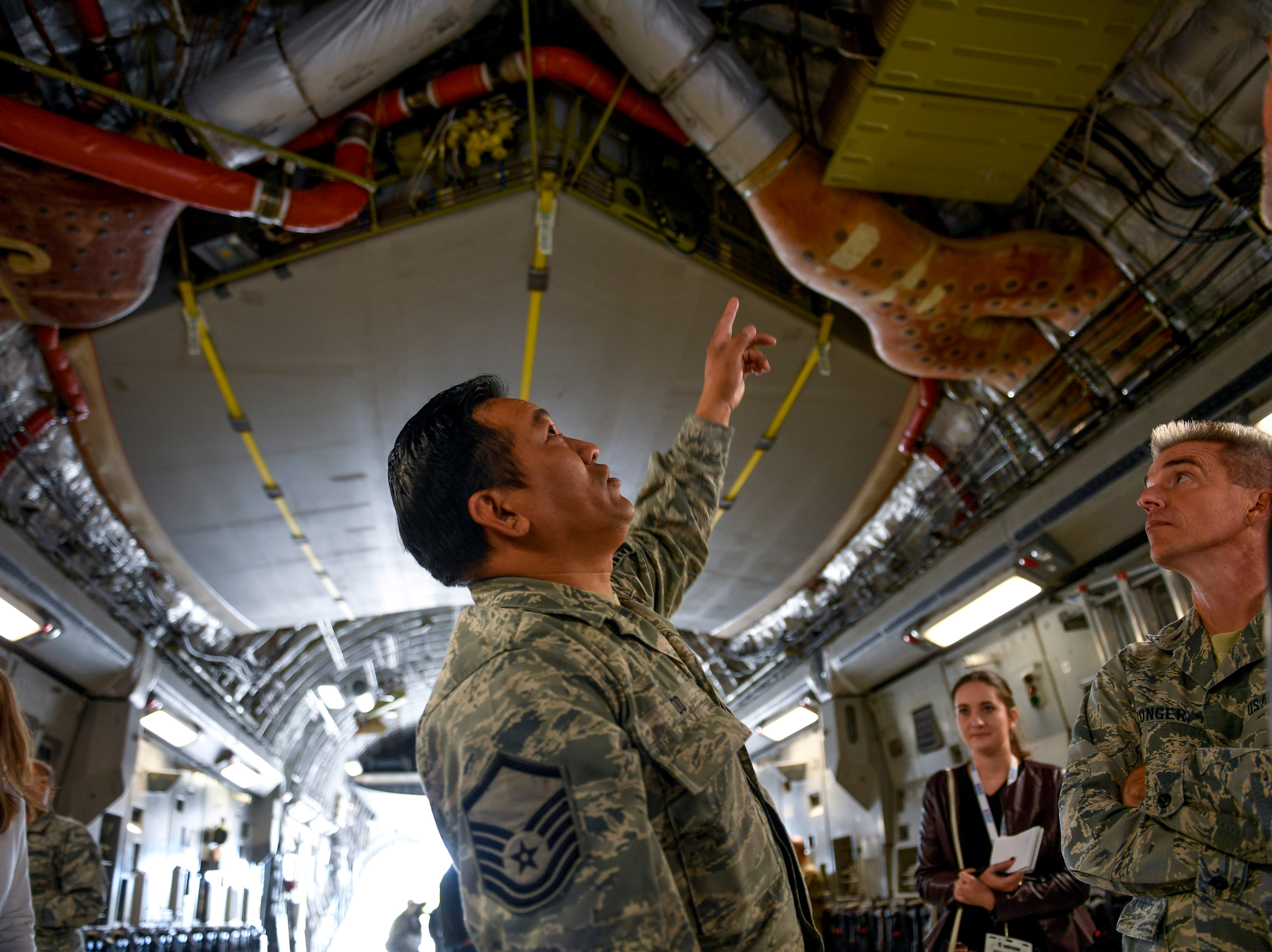National Guardsmen explain the insides of a C-17 fuselage to attendees during the annual Bosslift event put on by Employer Support of the Guard and Reserve (ESGR) and the Tennessee National Guard at 164th Airlift Wing in Memphis, Tenn., on Thursday, Nov. 8, 2018.