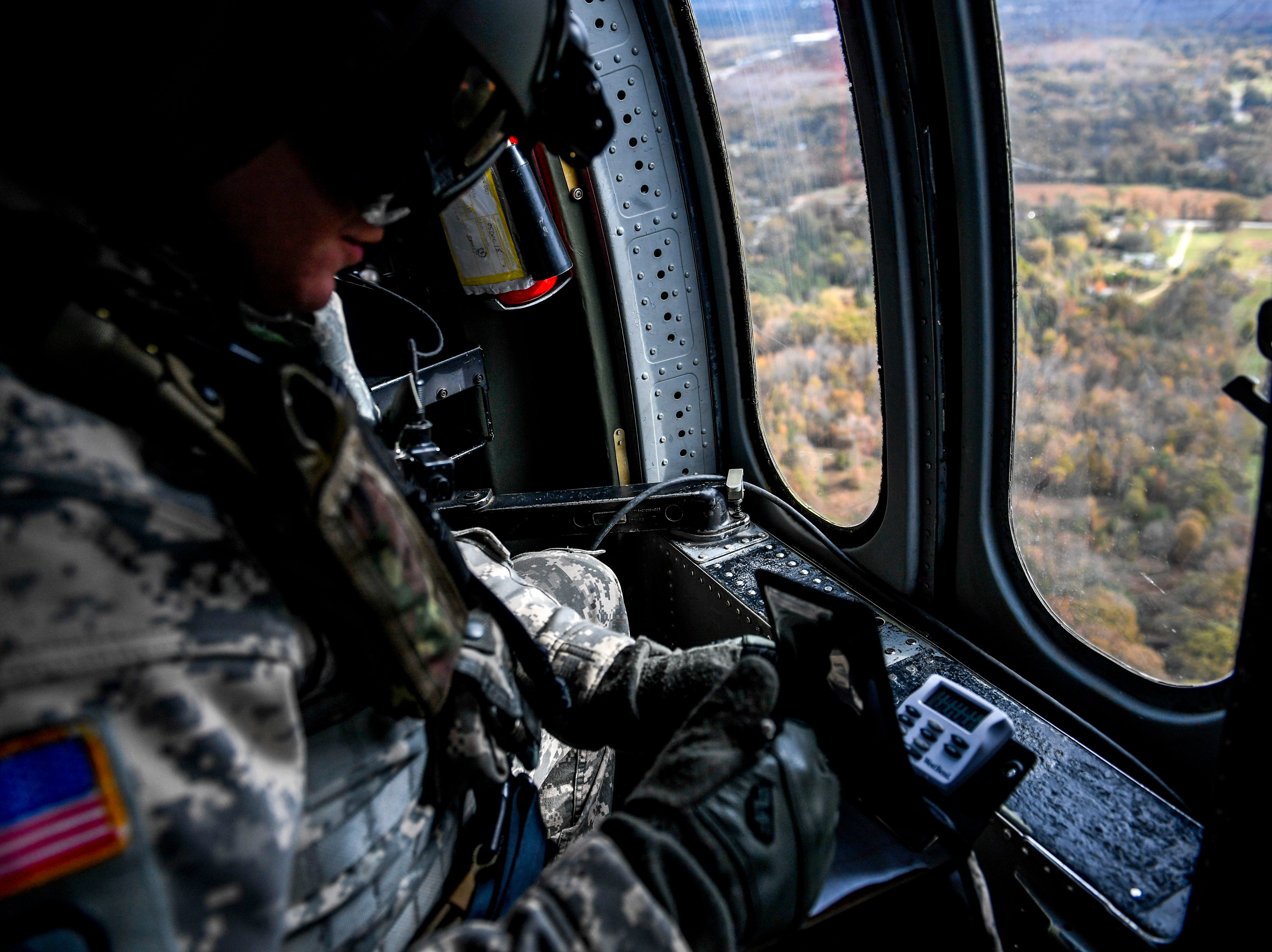 A National Guardsmen keeps records in a small log book during the annual Bosslift event put on by Employer Support of the Guard and Reserve (ESGR) and the Tennessee National Guard at Army Aviation Facility in Jackson, Tenn., on Thursday, Nov. 8, 2018.