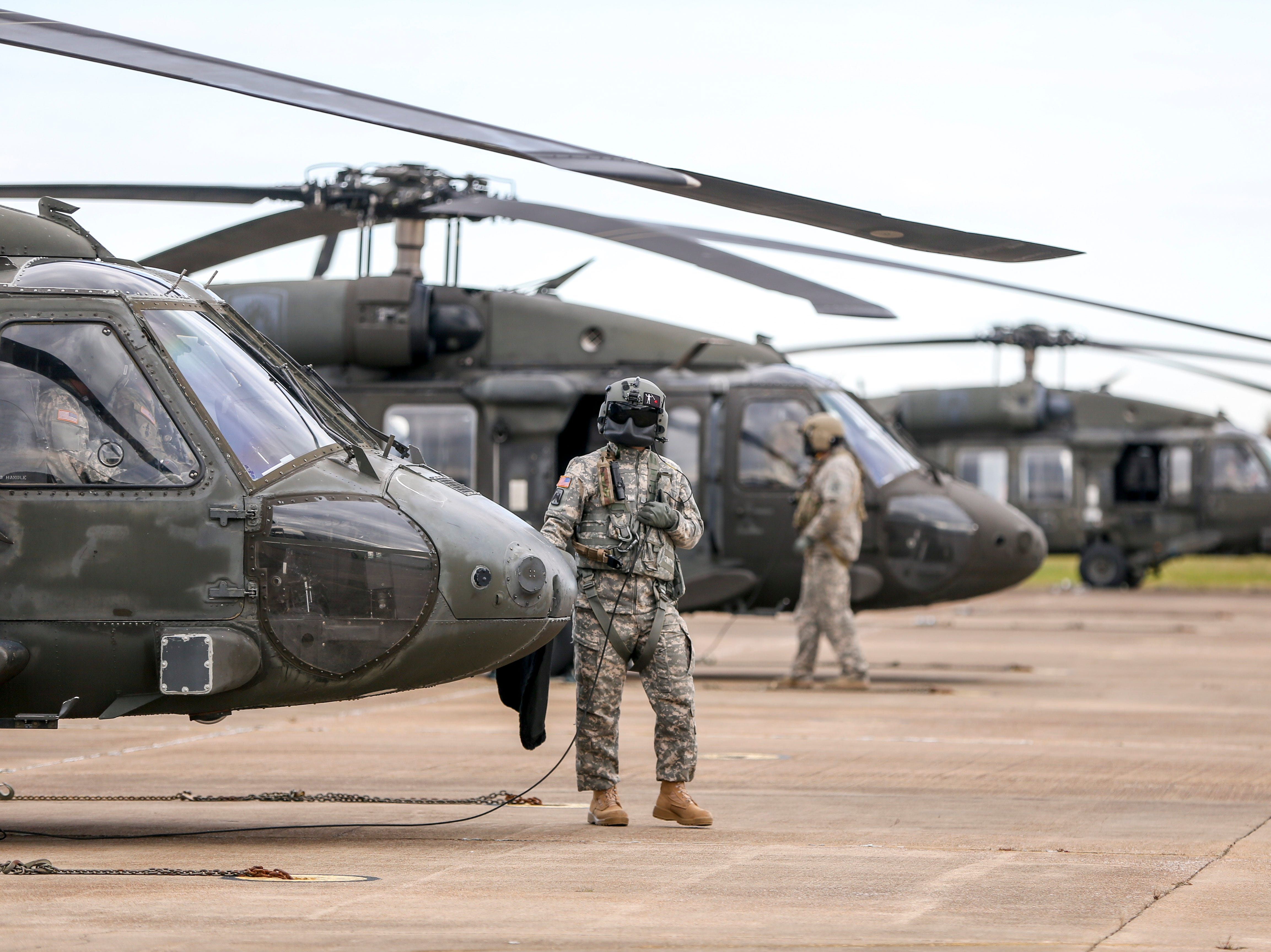 National Guardsmen prepare their Black Hawk helicopters for flight during the annual Bosslift event put on by Employer Support of the Guard and Reserve (ESGR) and the Tennessee National Guard at Army Aviation Facility in Jackson, Tenn., on Thursday, Nov. 8, 2018.