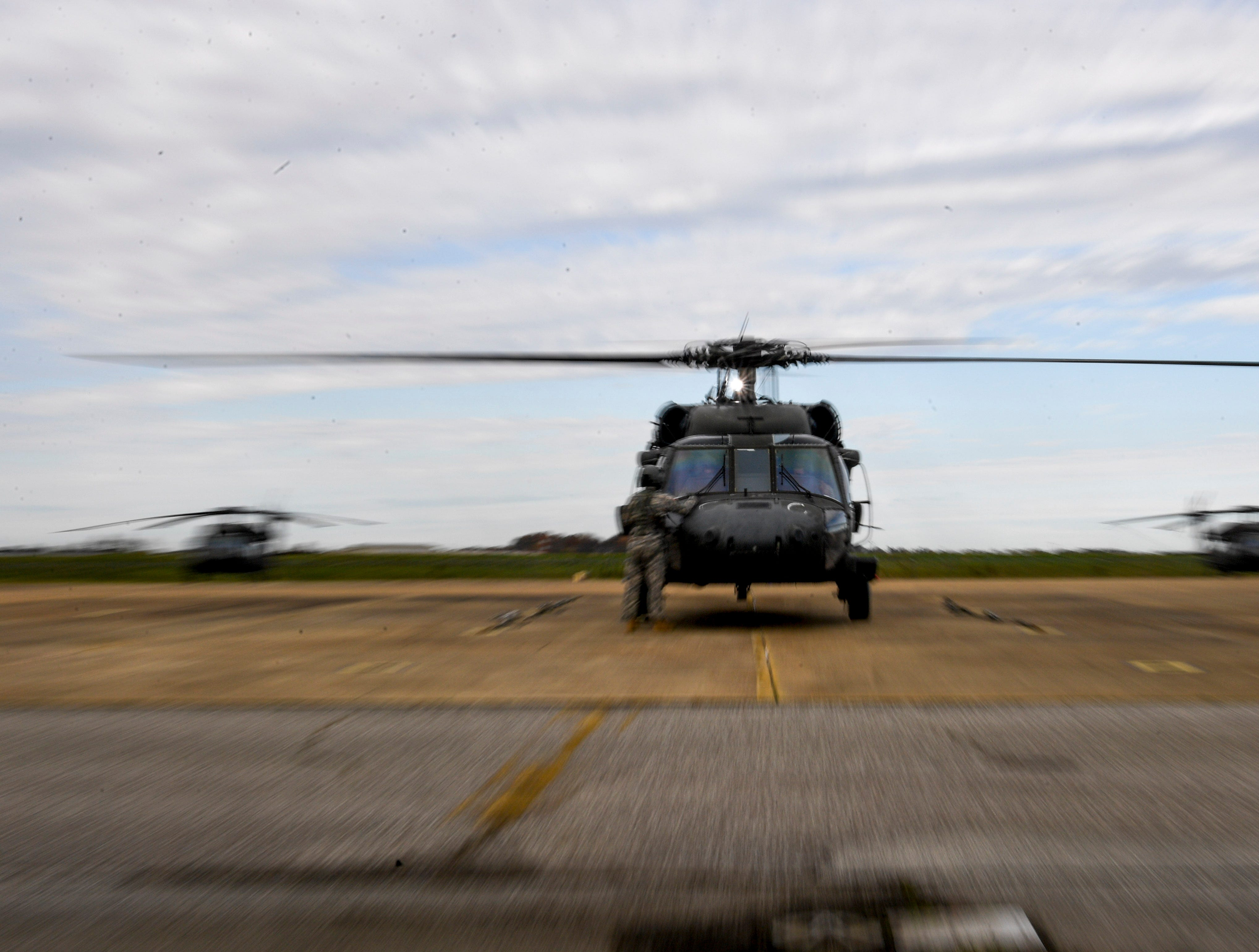 National Guardsmen prepare their helicopters for a flight during the annual Bosslift event put on by Employer Support of the Guard and Reserve (ESGR) and the Tennessee National Guard at Army Aviation Facility in Jackson, Tenn., on Thursday, Nov. 8, 2018.
