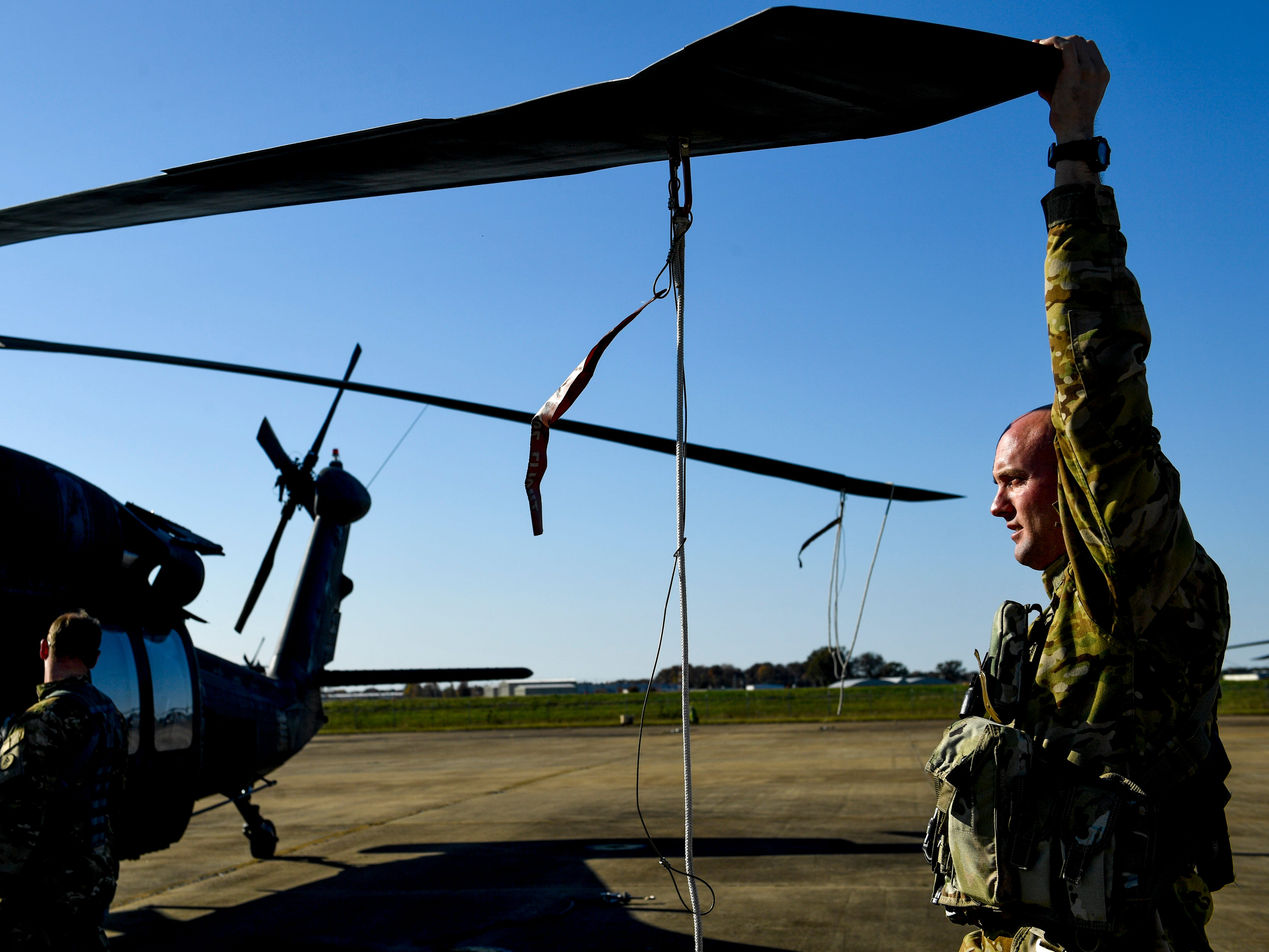 A National Guardsmen winds his helicopter blades into storage position during the annual Bosslift event put on by Employer Support of the Guard and Reserve (ESGR) and the Tennessee National Guard at Army Aviation Facility in Jackson, Tenn., on Thursday, Nov. 8, 2018.
