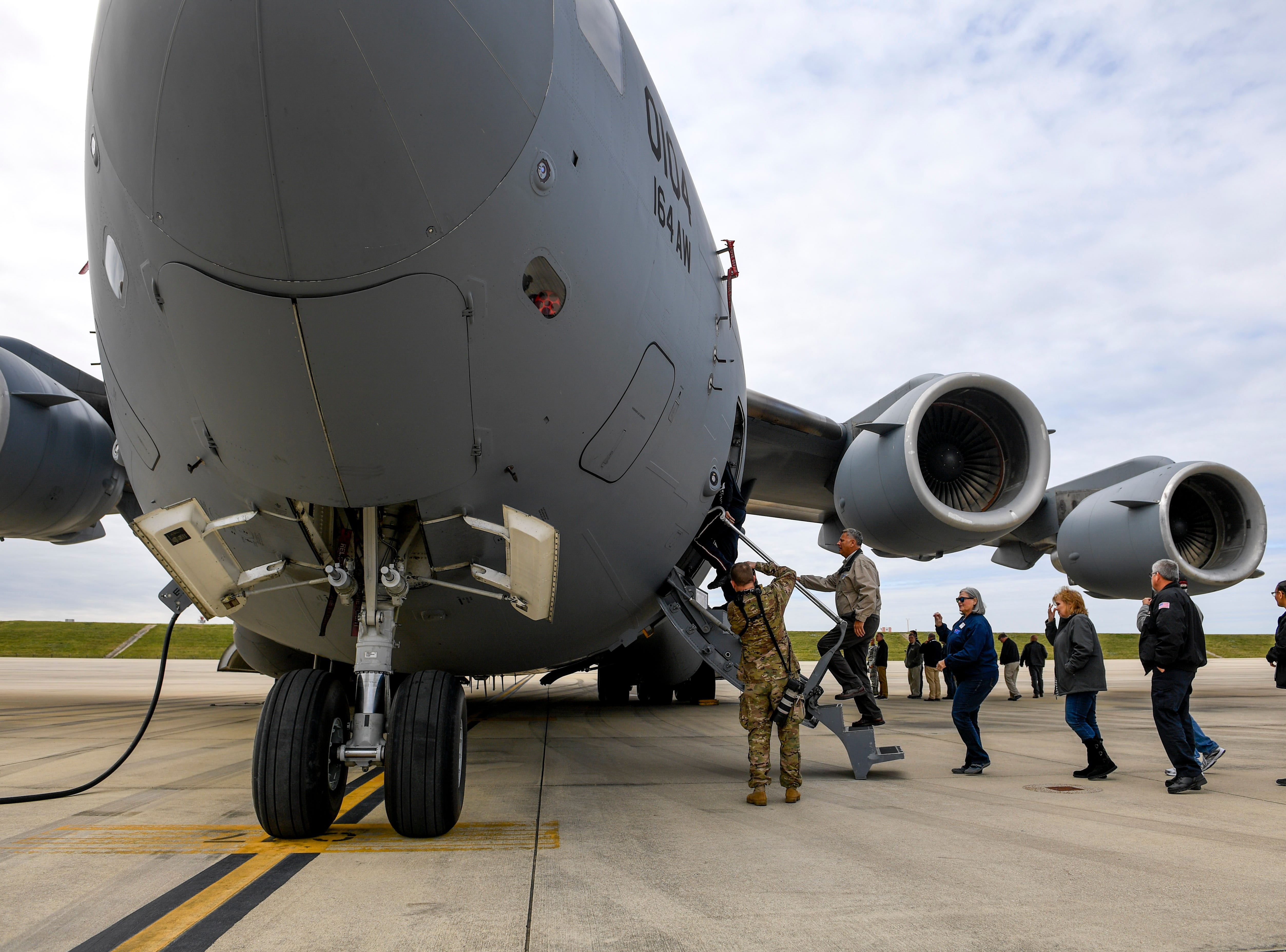 Attendees enter a C-17 airplane during the annual Bosslift event put on by Employer Support of the Guard and Reserve (ESGR) and the Tennessee National Guard at 164th Airlift Wing in Memphis, Tenn., on Thursday, Nov. 8, 2018.