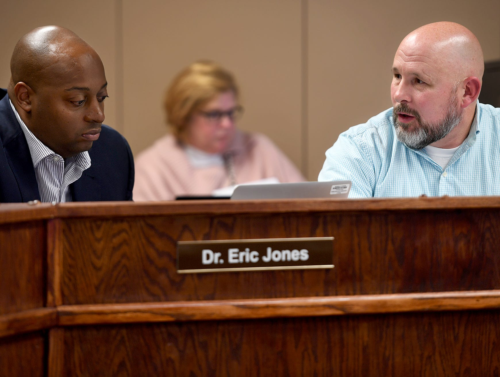 Jackson-Madison County Schools' Superintendent Dr. Eric Jones and Chairman Kevin Alexander discuss one of the items on the agenda during their November 8 board meeting.