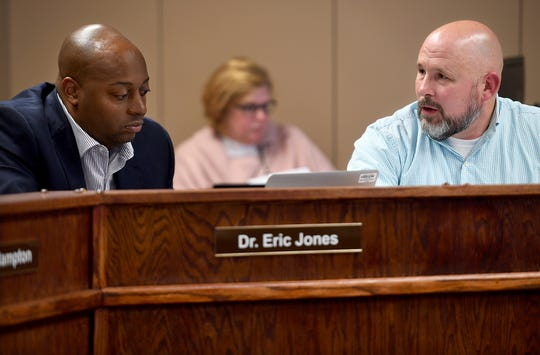 Jackson-Madison County School System Superintendent Eric Jones and board member Kevin Alexander discuss an item on the agenda during a meeting Nov. 8. Jones resigned Friday.