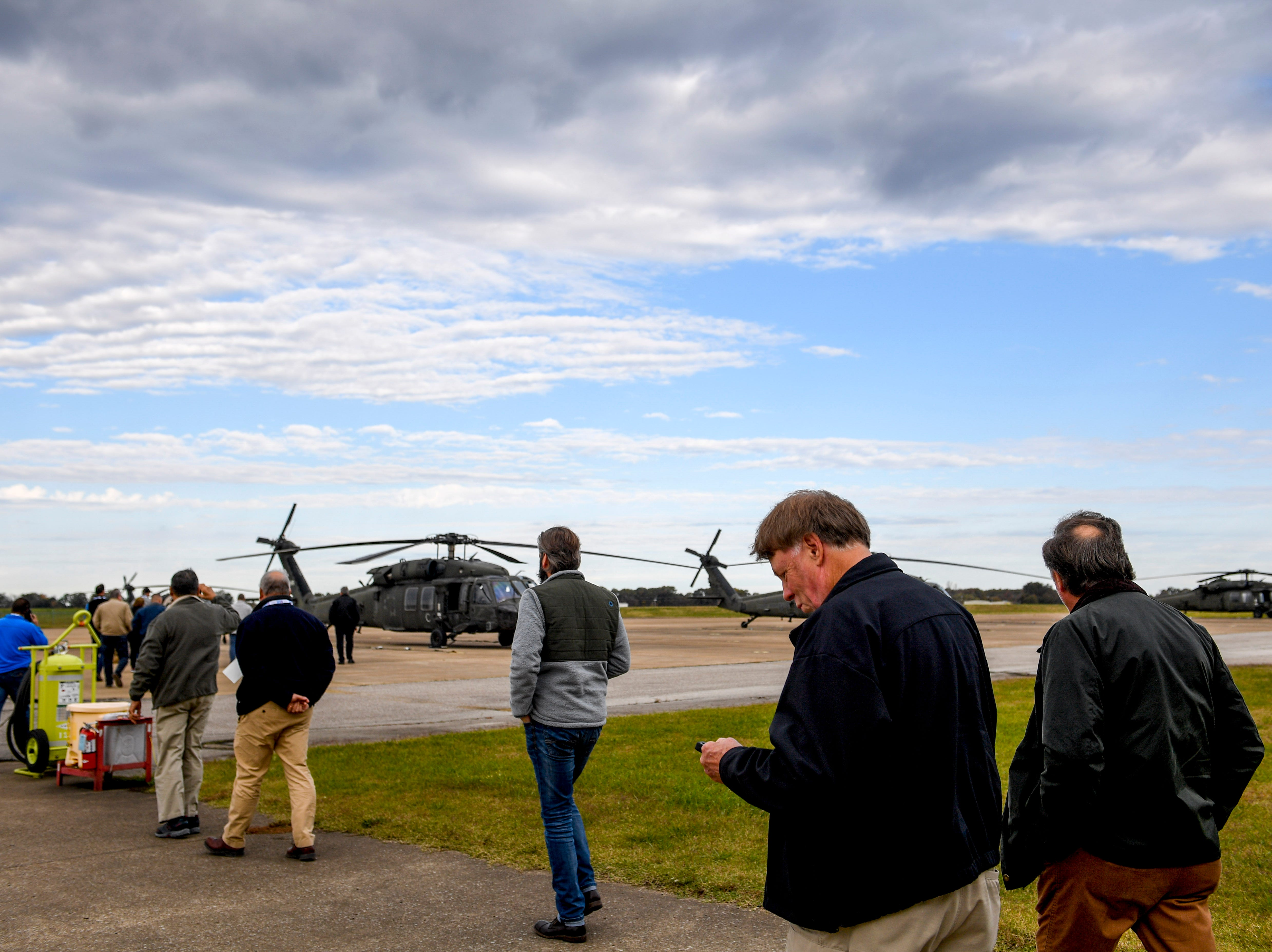 Attendees including Madison County Sheriff John Mehr approach helicopters during the annual Bosslift event put on by Employer Support of the Guard and Reserve (ESGR) and the Tennessee National Guard at Army Aviation Facility in Jackson, Tenn., on Thursday, Nov. 8, 2018.