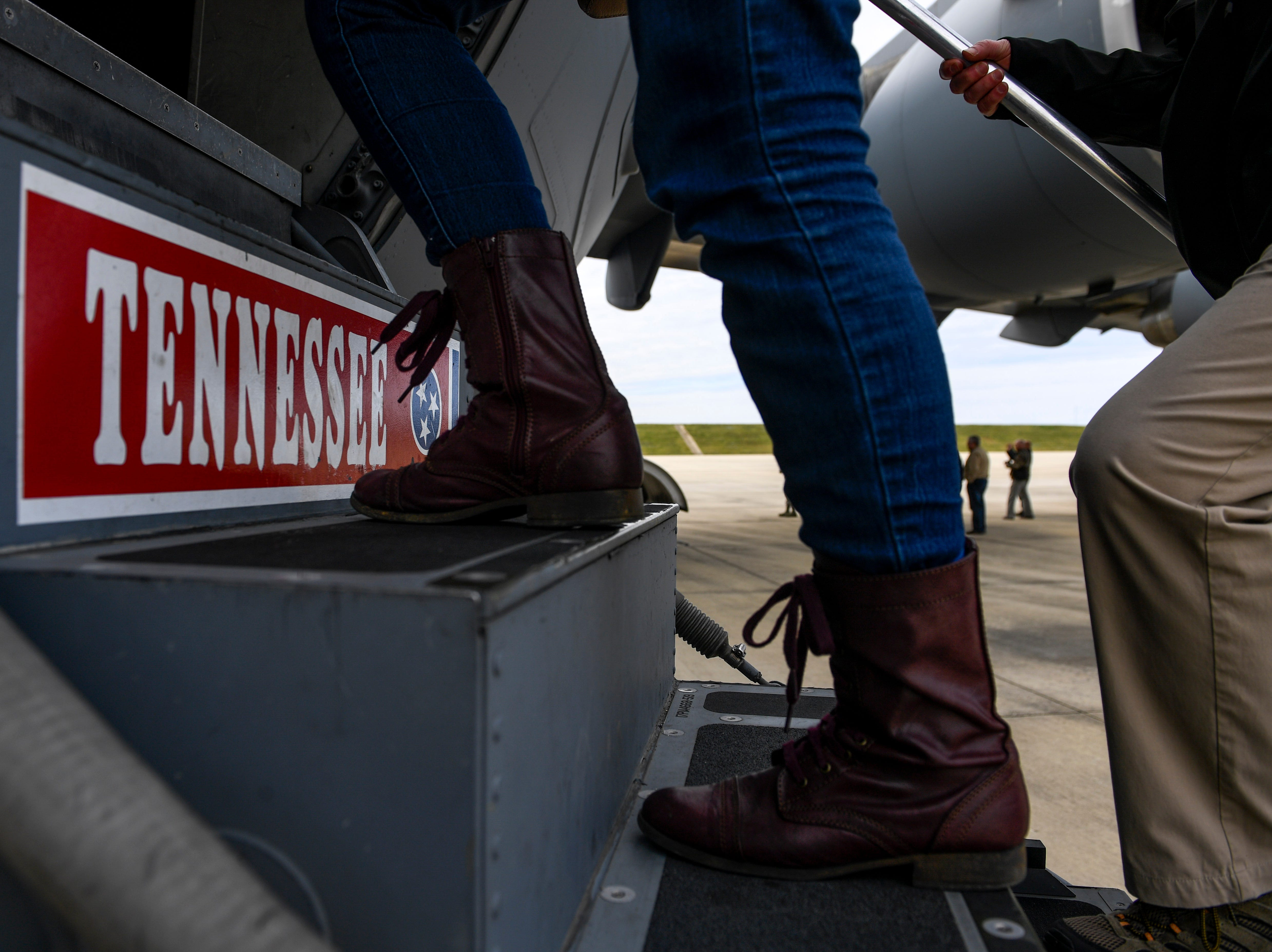 Attendees walk up steps to enter the C-17 during the annual Bosslift event put on by Employer Support of the Guard and Reserve (ESGR) and the Tennessee National Guard at 164th Airlift Wing in Memphis, Tenn., on Thursday, Nov. 8, 2018.