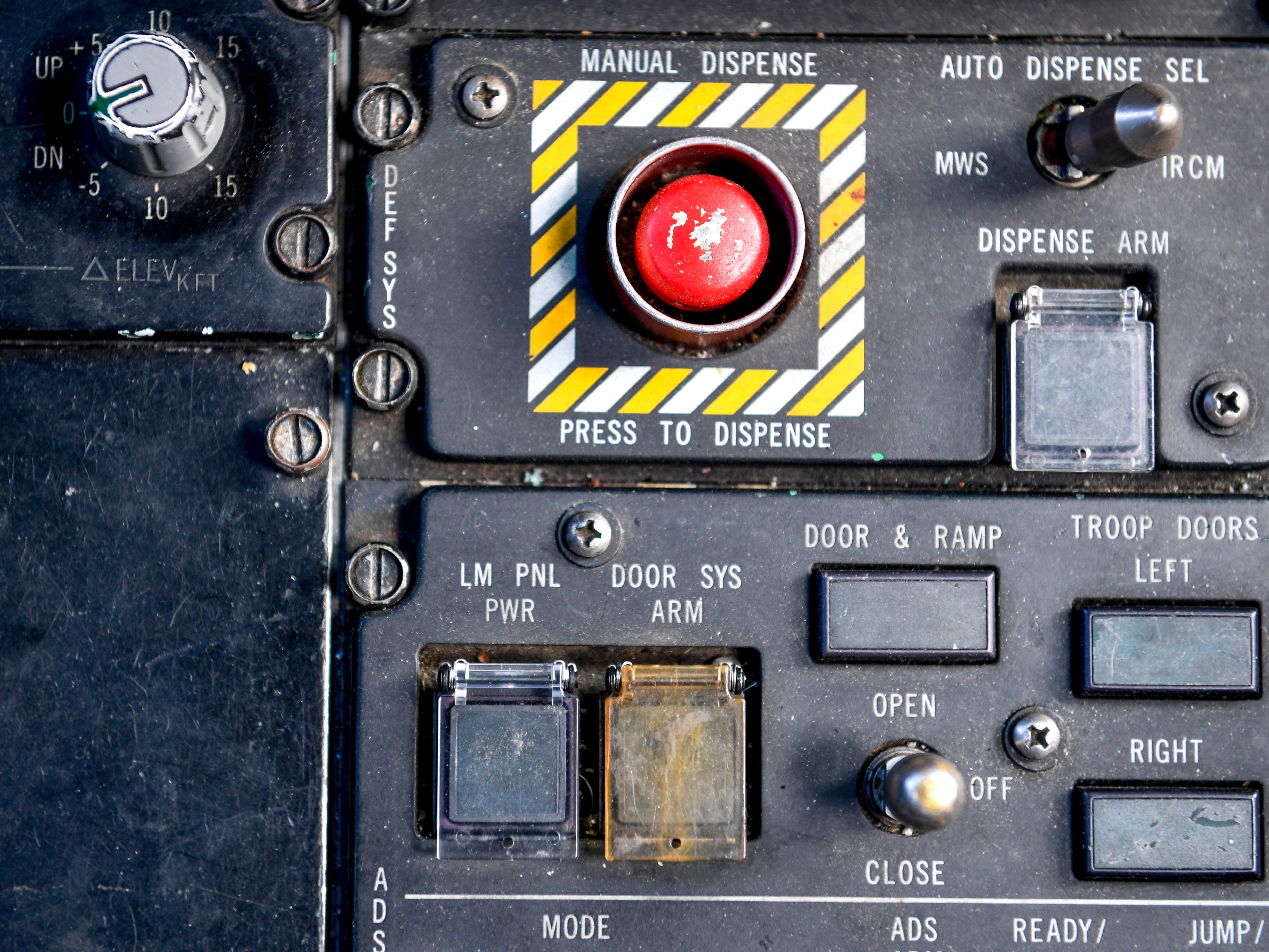 A big red button that initiates defense systems can be seen in the cockpit of a C-17 during the annual Bosslift event put on by Employer Support of the Guard and Reserve (ESGR) and the Tennessee National Guard at 164th Airlift Wing in Memphis, Tenn., on Thursday, Nov. 8, 2018.