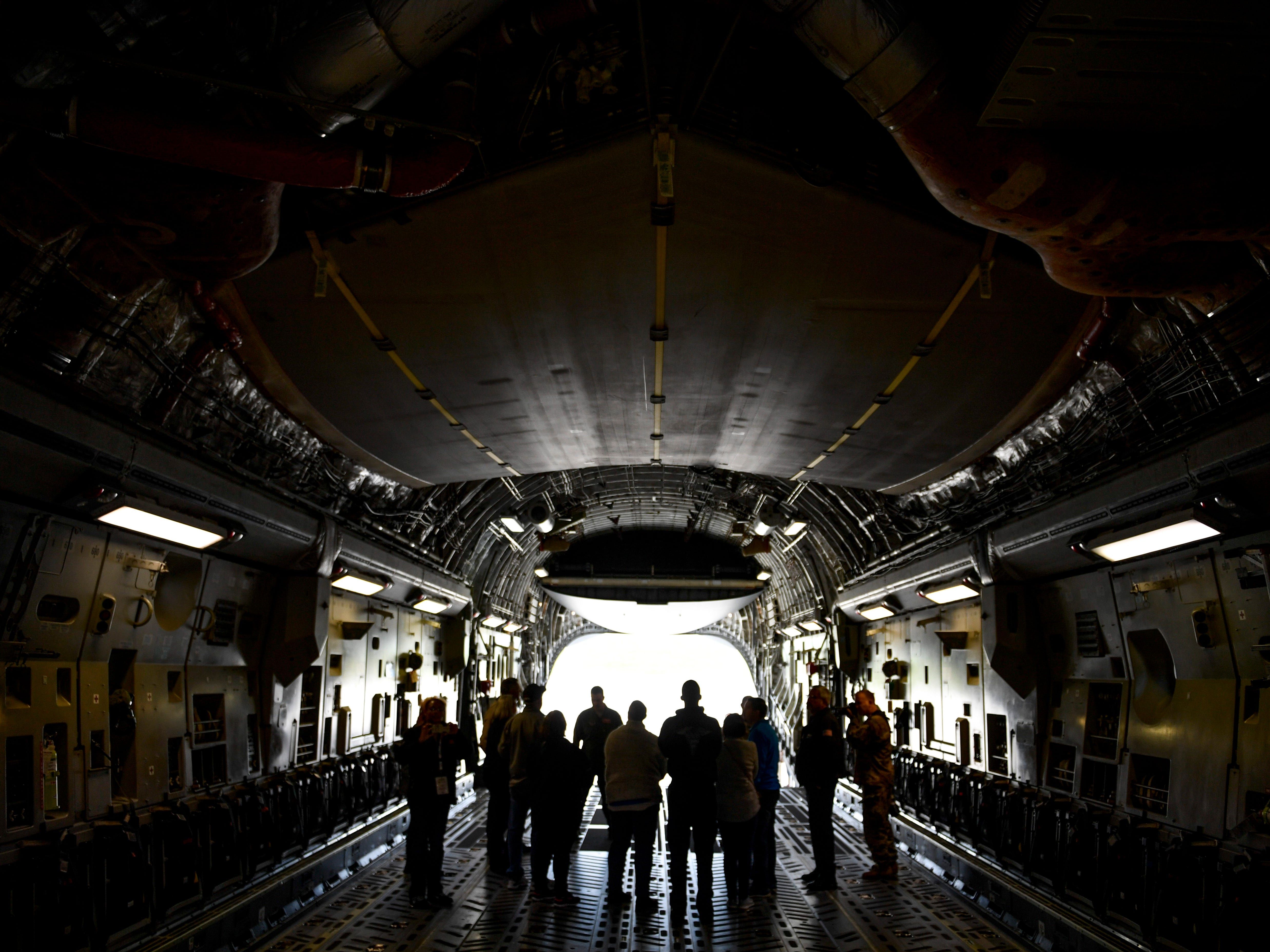 Attendees stand and chat with National Guardsmen in the fuselage of a C-17 during the annual Bosslift event put on by Employer Support of the Guard and Reserve (ESGR) and the Tennessee National Guard at 164th Airlift Wing in Memphis, Tenn., on Thursday, Nov. 8, 2018.