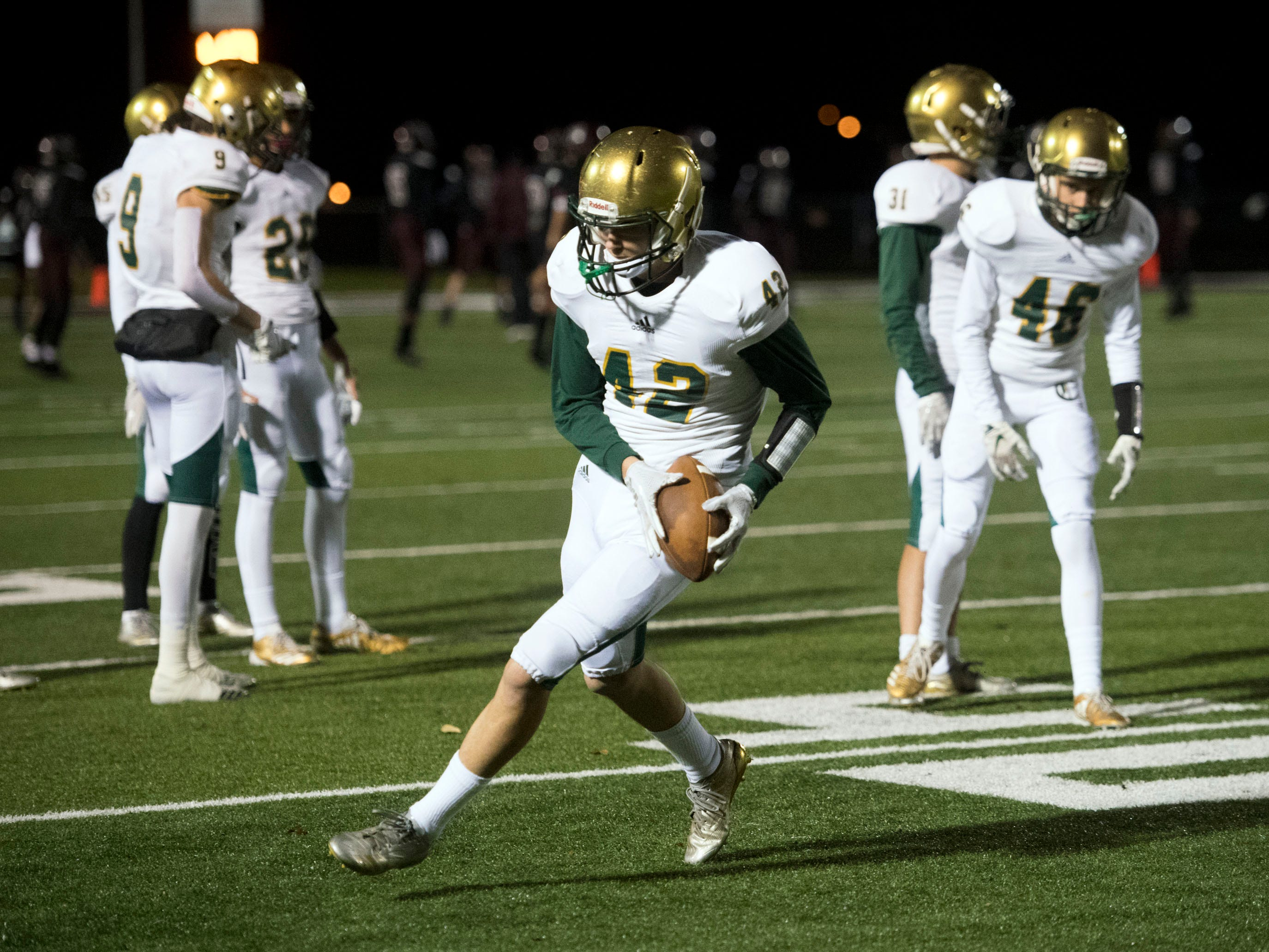 Knoxville Catholic's Seth Lawson (42) warms up before the start of the Class 5A second round playoff game against Fulton on Friday, November 9, 2018.