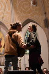 David Francisco and his wife Kristi hug after performing a song together during a secret Sofar Sounds show at St. Johns Cathedral in Knoxville on Thursday.