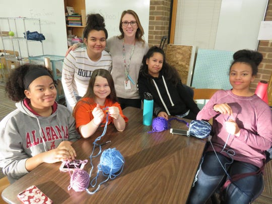 Among those participating in a makerspace knitting activity at Bearden Middle School for scarves for Shannondale of Knoxville residents are, seated from left, Shanae Wyrick, Jada Tilson, Samantha Varillas, and Leyann Wyrick. Standing are Arianna Kennedy, left, and faculty adviser Christen Marcus.
