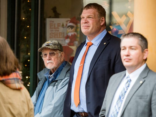 Knox County Mayor Glenn Jacobs, second from right, watches as Knoxville's 93rd Veterans Day Parade parades down Gay St. in downtown Knoxville on Friday, November 9, 2018.