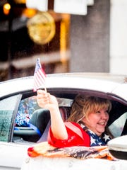State Rep.-elect Gloria Johnson waves to the crowd during Knoxville's 93rd Veterans Day Parade held in downtown Knoxville on Friday, November 9, 2018.