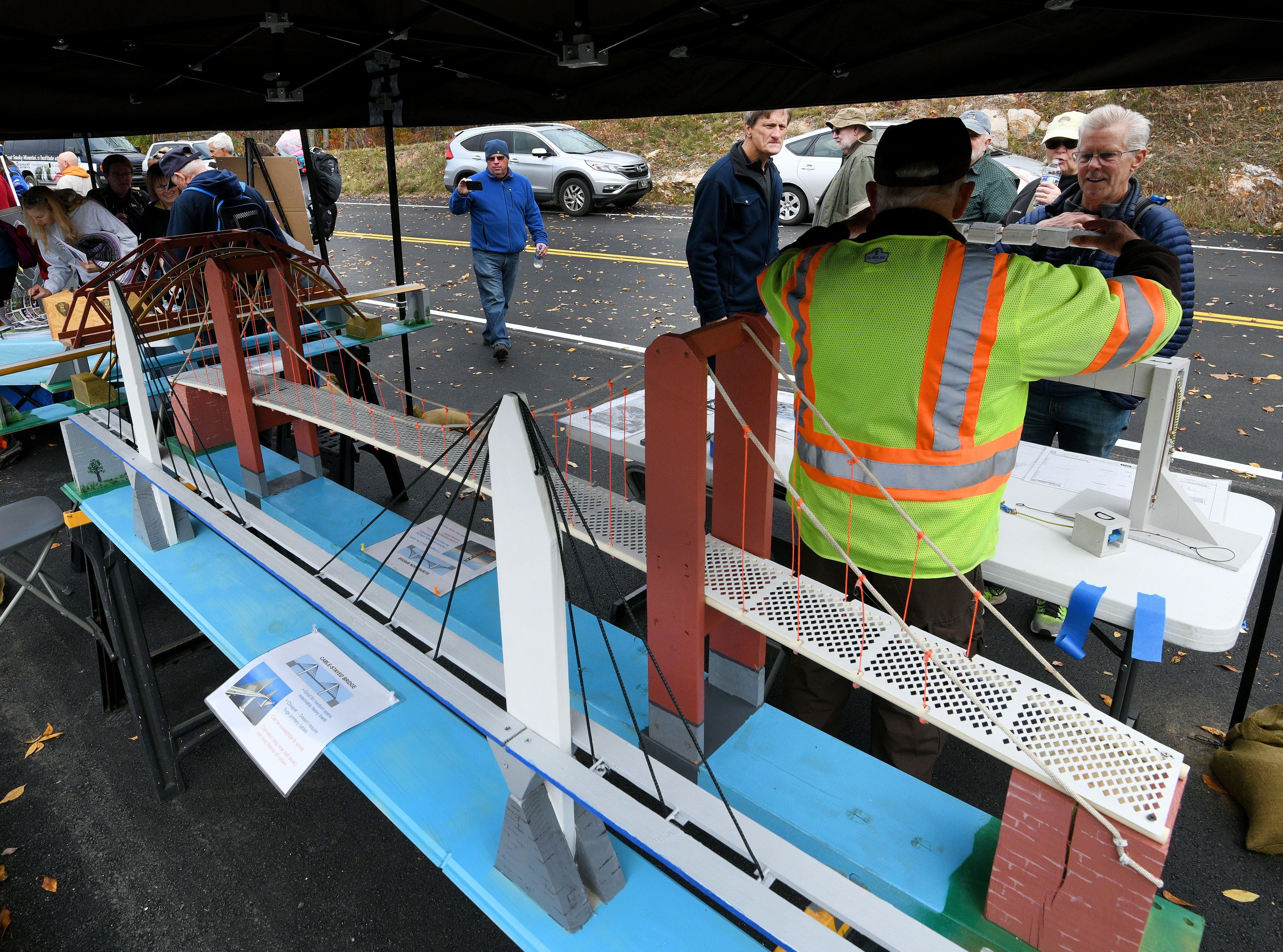 Volunteers from the National Park Service show visitors how the bridges were built during a Community Day held Thursday, Nov. 8, 2018 for the public to experience the bridges along the 1.65-mile section known as the 'Missing Link' before it opens to motorists and cyclists Saturday.