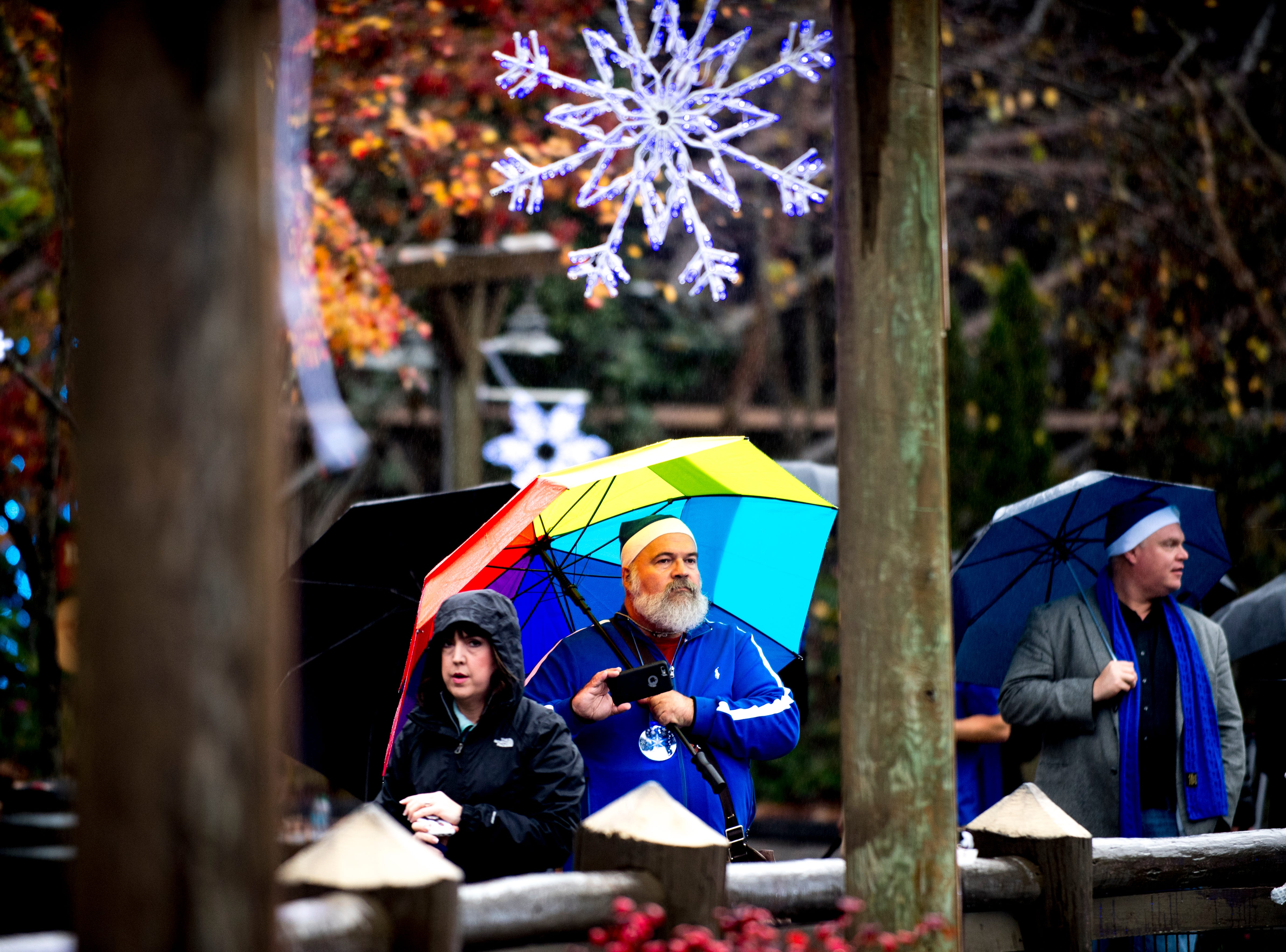 Visitors walk through the park during media day for a behind-the-scenes look of the Glacier Ridge light display at Dollywood in Pigeon Forge, Tennessee on Friday, November 9, 2018. Glacier Ridge features several new lighting displays, including a 50-ft. tall animated tree, the all new Arctic Passage and the Northern Lights.