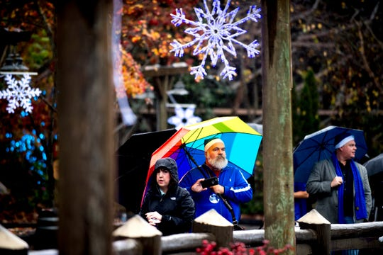 Visitors walk through the park during media day for a behind-the-scenes look of the Glacier Ridge light display at Dollywood Friday.