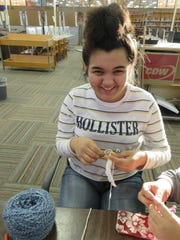 BMS student Arianna Kennedy has fun knitting scarves for Shannondale residents.
