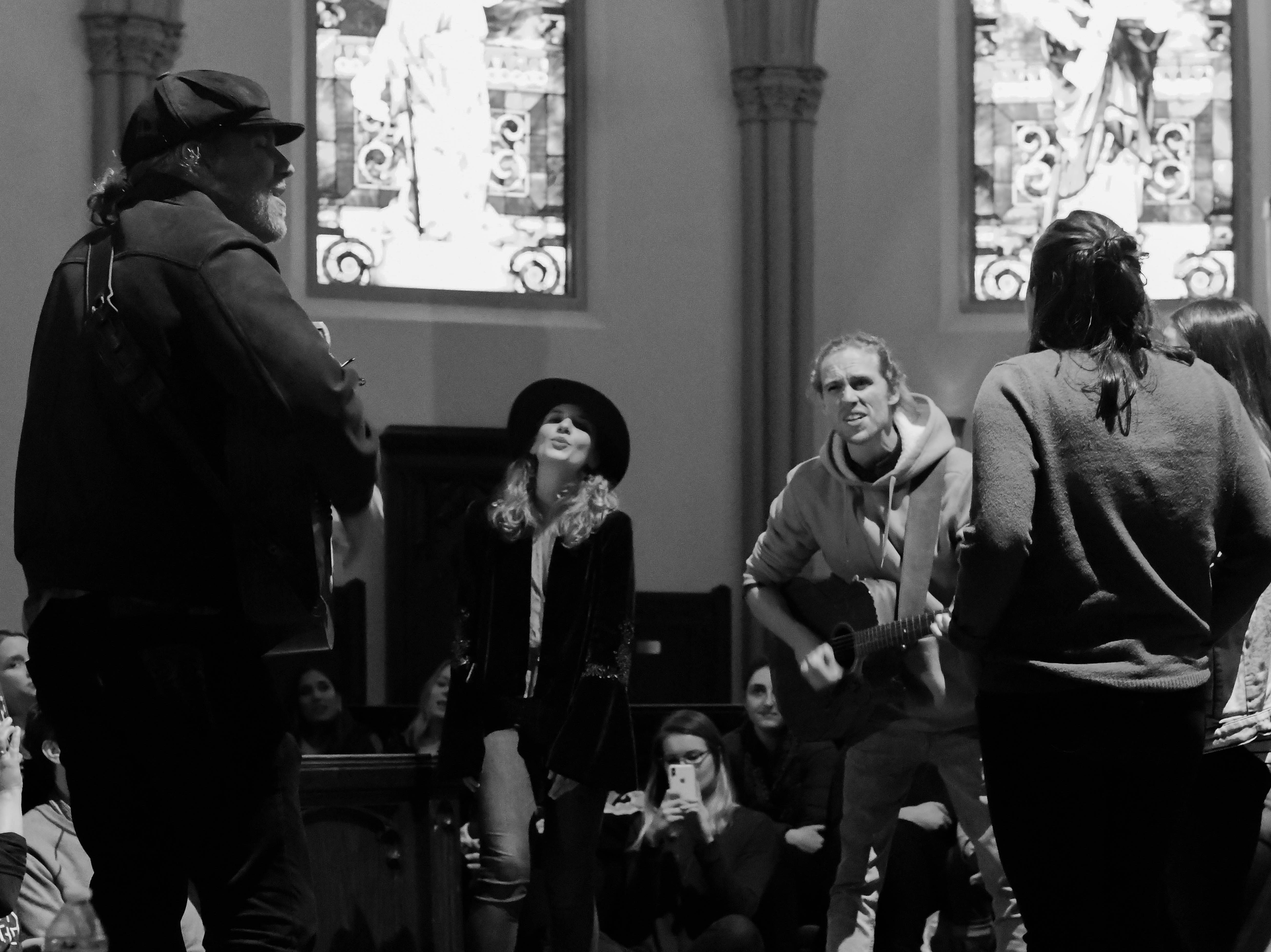 "Members of 5j Barrow (left), David Francisco (center) and FOX and the BEAR perform a rendition of Leonard Cohen's ""Hallelujah"" during a secret Sofar Sounds show at St. Johns Cathedral on Nov. 8, 2018."