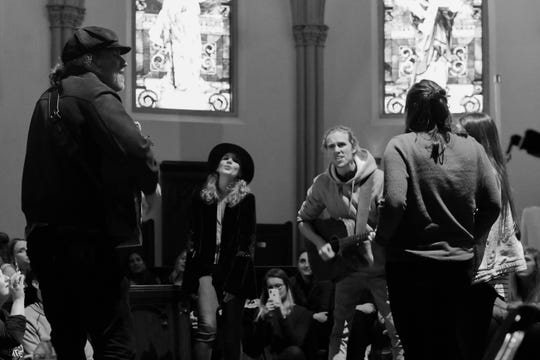 """Members of 5j Barrow (left), David Francisco (center) and FOX and the BEAR perform a rendition of Leonard Cohen's """"Hallelujah"""" during a secret Sofar Sounds show at St. Johns Cathedral on Thursday."""