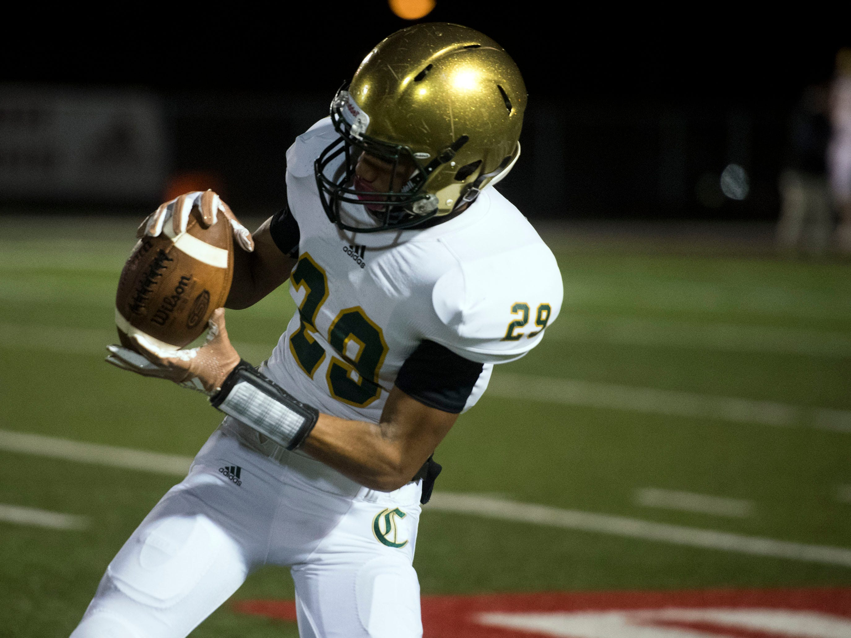 Knoxville Catholic's Isaac Franklin (29) warms up before the start of the playoff game against Fulton on Friday, November 9, 2018.