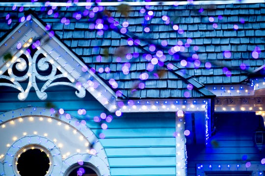 Lights decorate a building and tree during media day for a behind-the-scenes look of the Glacier Ridge light display at Dollywood on Friday.