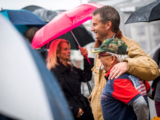 Congressman-elect Tim Burchett takes photos with veterans on Gay St. before the start of Knoxville's 93rd Veterans Day Parade held in downtown Knoxville on Friday, November 9, 2018.