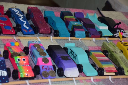A few of the more than 90 creatively designed derby cars prepared to compete at the Girl Scout Daisy Derby held at Beaver Ridge United Methodist Church Saturday, Nov. 3.