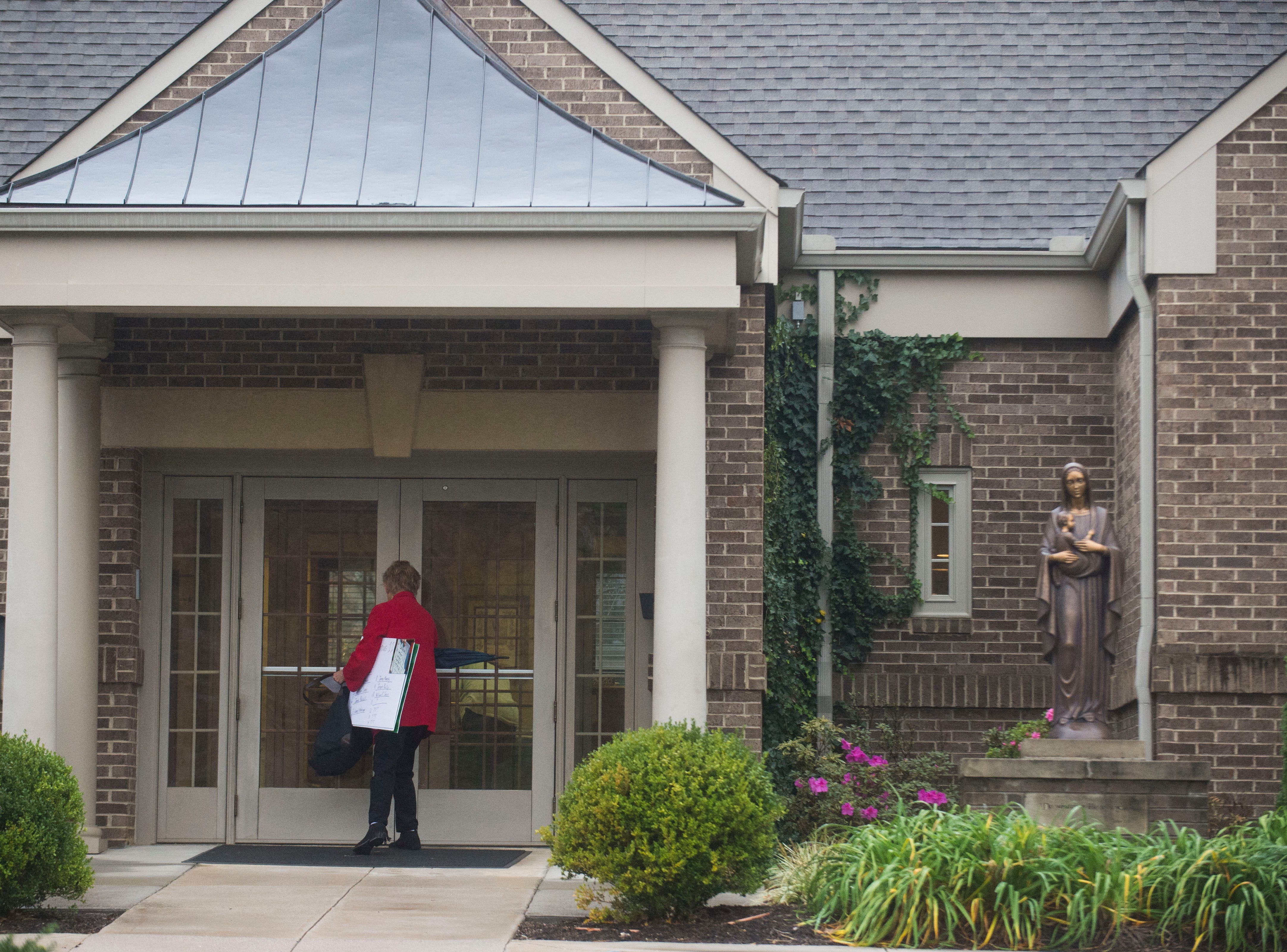 Susan Vance of the Survivors Network of those Abused by Priests, known as SNAP, attempts to deliver a letter to the Chancery Office of the Diocese of Knoxville about alleged Catholic clergy abuse in Tennessee on Nov. 9, 2018.