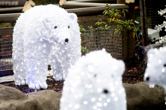 Illuminated polar bears welcome visitors during media day for a behind-the-scenes look of the Glacier Ridge light display at Dollywood in Pigeon Forge on Friday.