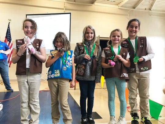"""Winners pictured from left are Kamarin May, """"Best in Show"""" for the Daisy and Brownie Division, Abigail Moazen, second place Daisy, Guinevere Rice second place Brownie, Layla Maddux, third place Brownie, Kate Feret, first place Brownie at the Girl Scout Daisy Derby held at Beaver Ridge United Methodist Church Saturday, Nov. 3."""