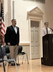 Jack Turrentine introduces the featured speaker, Master Gunnery Sgt. Joseph M. Esway, USMC/Retired, at Gresham Middle School's Veterans Day Assembly on Nov. 9.