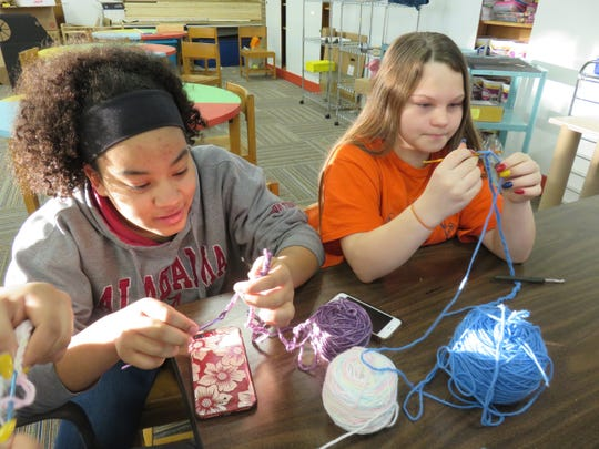 Shanae Wyrick, left, and Jada Tilson practice their knitting as part of a makerspace activity at Bearden Middle School.