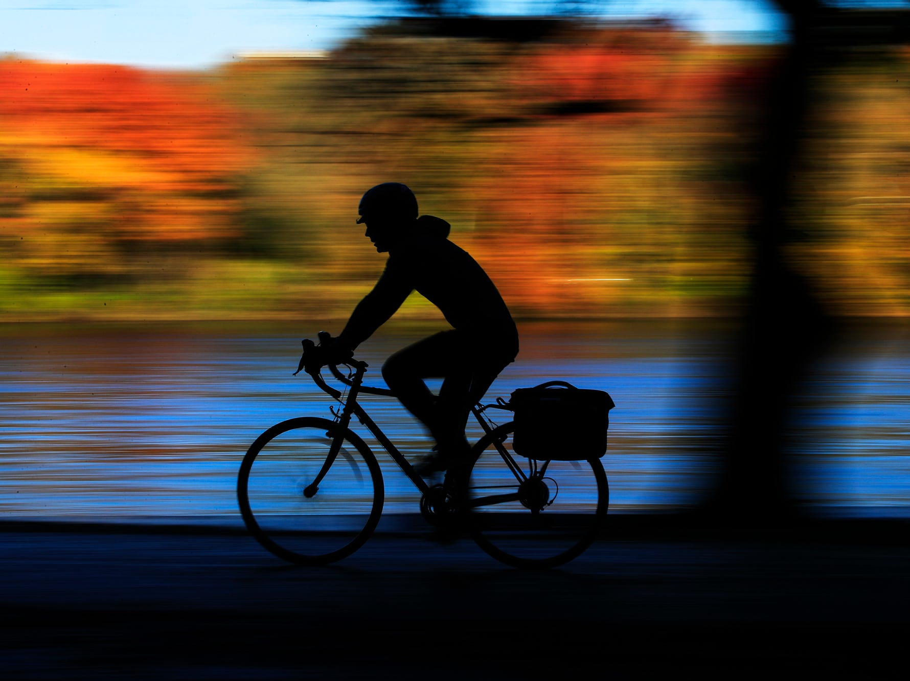 A cyclist makes their way along Kelly Drive on an autumn morning in Philadelphia, Wednesday, Nov. 7, 2018. (AP Photo/Matt Rourke)
