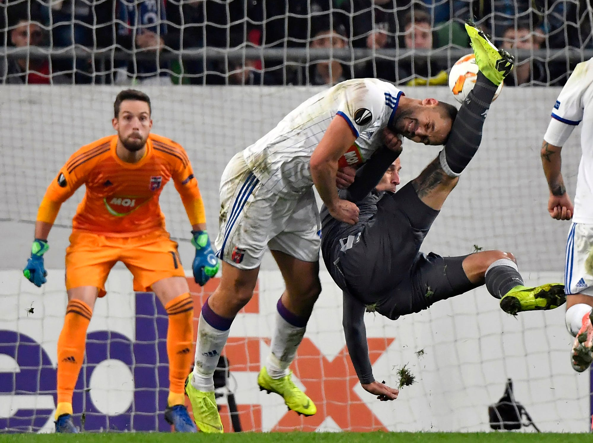 Roland Juhasz of Vidi, centre, in action against Aleksandar Prijovic of PAOK, right, during their Europa League Group L fourth round soccer match of MOL Vidi FC of Hungary vs PAOK Thessaloniki of Greece in Groupama Arena in Budapest, Hungary, Thursday, Nov. 8, 2018.  Vidi went on to win the match 1-0. (Tibor Illyes/MTI via AP)