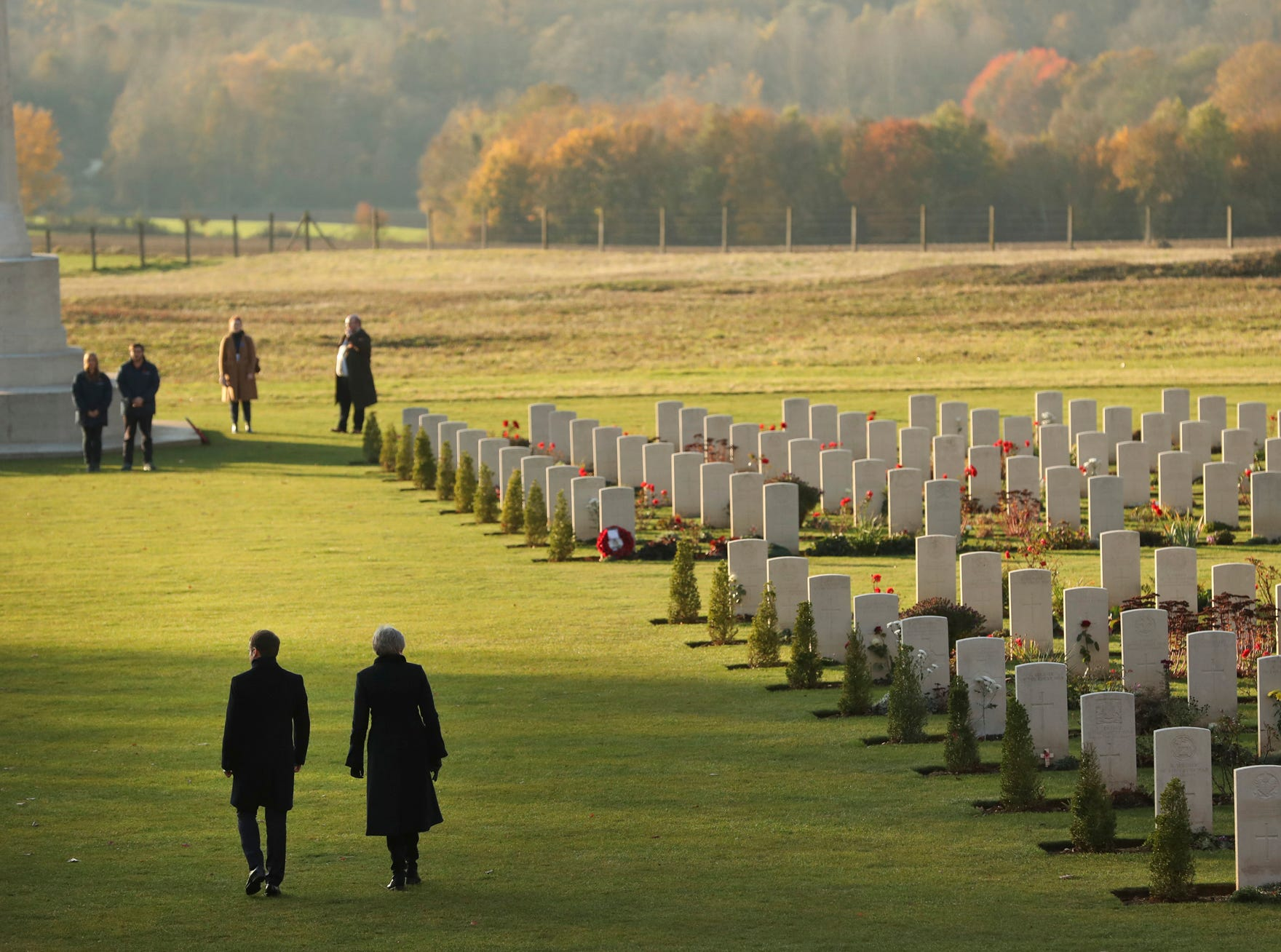 British Prime Minister Theresa May, right, and French President Emmanuel Macron, left, walk together after laying wreaths at the World War I Thiepval Memorial in Thiepval, France, Friday, Nov. 9, 2018. The memorial commemorates more than 72,000 men of British and South African forces who died in the Somme. (AP Photo/Francisco Seco, Pool)