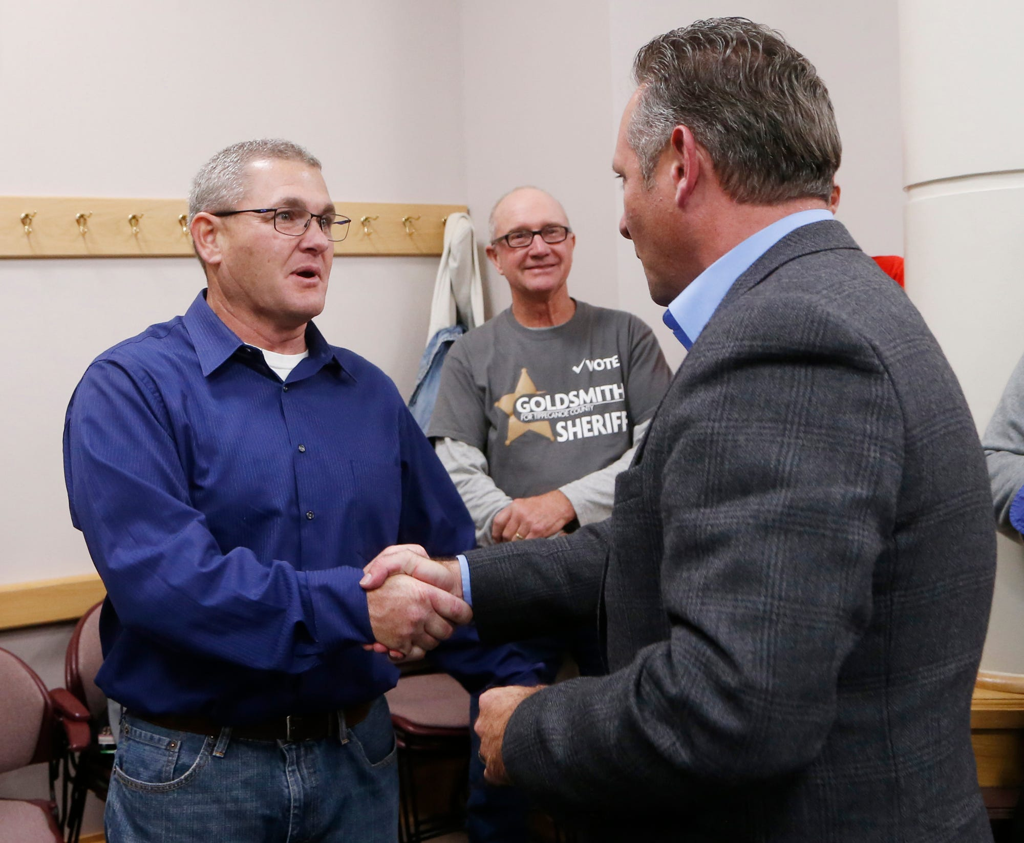 Bob Goldsmith, left, and Jason Dombkowski shake hands at the County Office Building Tuesday, November 6, 2018, in Lafayette. Goldsmith, a Democrat, narrowly defeated Republican Dombkowski in the race for Tippecaoe County Sheriff.