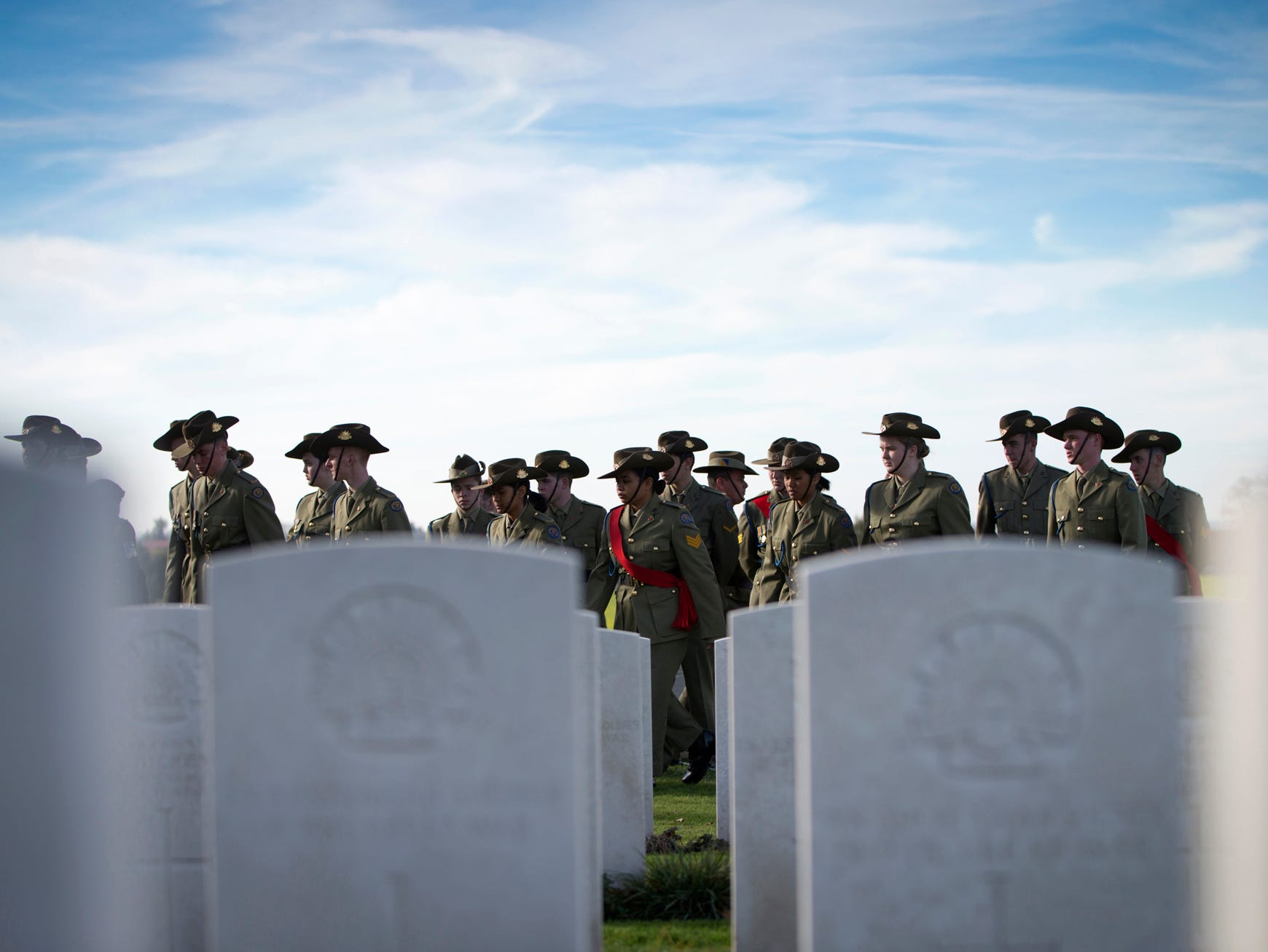 Australian soldiers gather to participate in the reburial of two unidentified World War I Australian soldiers and one British Soldier at Tyne Cot cemetery in Zonnebeke, Belgium, Tuesday, Nov. 6, 2018. The soldiers were found in Belgium during construction works in 2016. (AP Photo/Virginia Mayo)