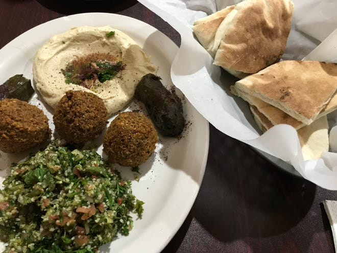 The Mazaa Platter at West Nile in West Lafayette includes hummus, tabbouleh, falafel and grape leaves.