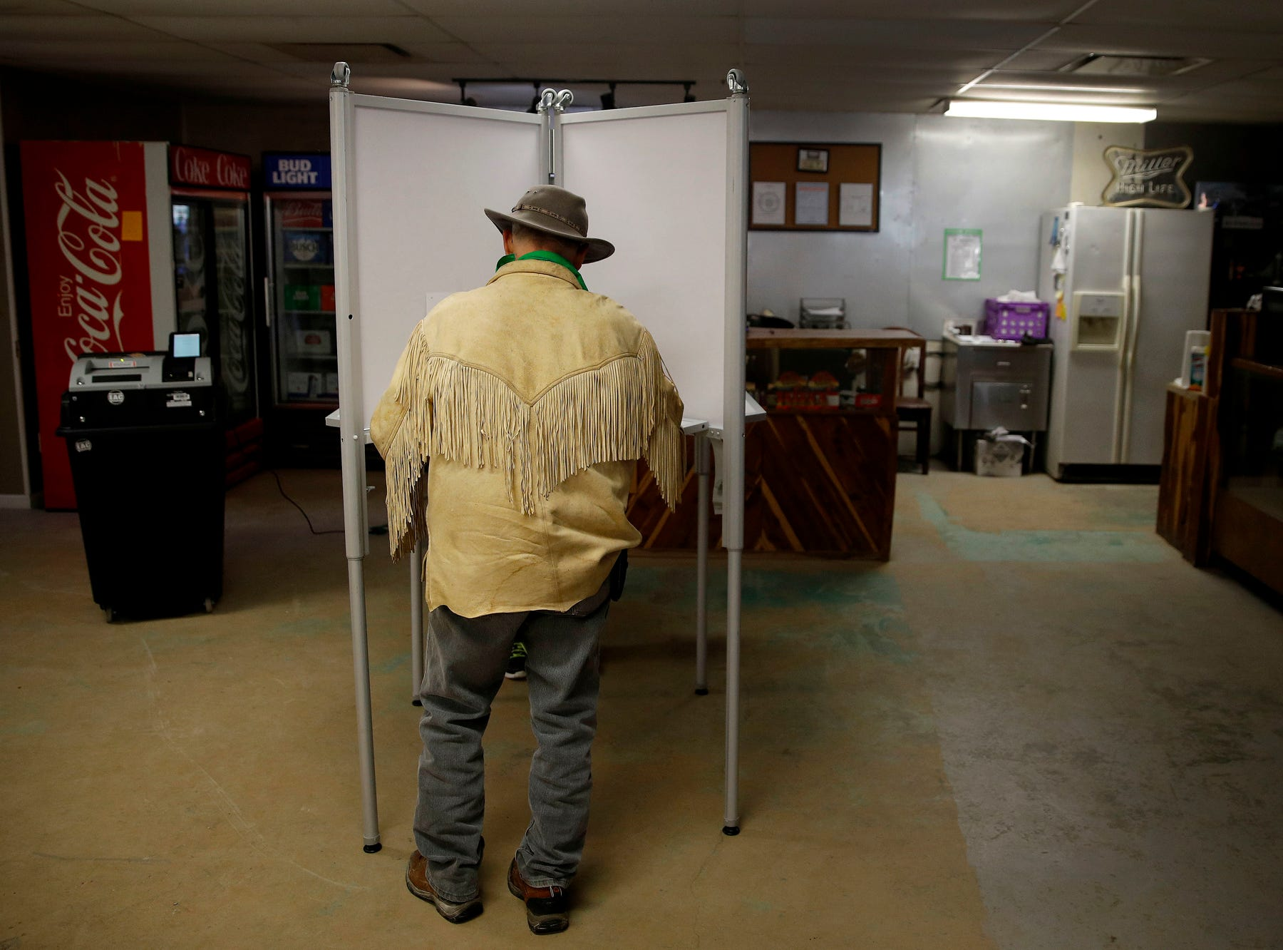 Stuart Wood, from Stockton, Mo., votes at Caplinger Woods RV & Campgrounds, Tuesday, Nov. 6, 2018, in Stockton, Mo. (AP Photo/Charlie Riedel)