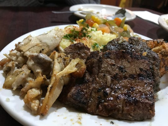 The combo kebab entree at Blue Nile in West Lafayette includes chicken shish taouk and chicken, lamb and beef shawarma.
