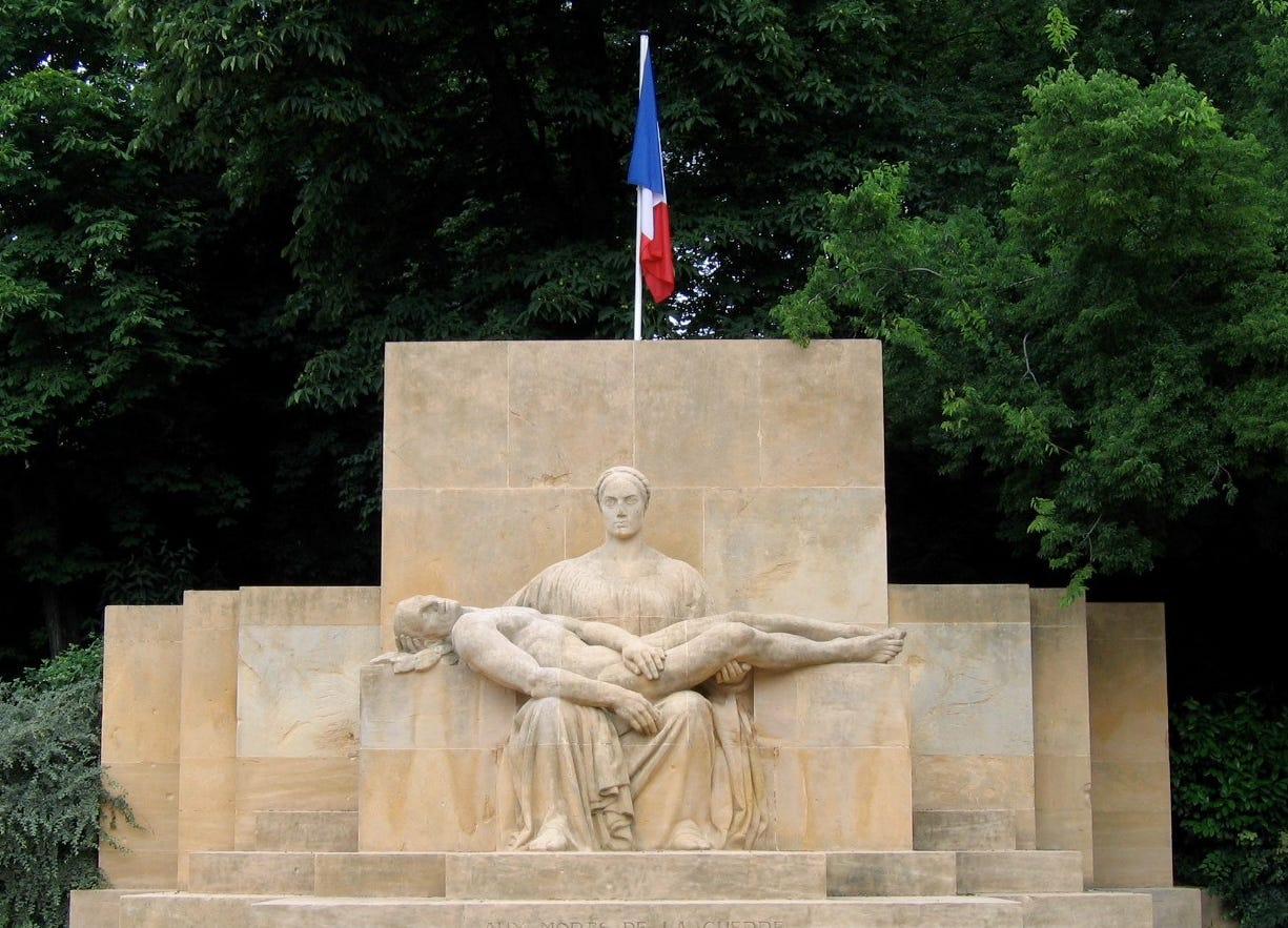 "Depicting a mother holding a fallen son, this memorial in Metz, France includes the simple inscription ""To the war dead.""  The world remembered its fall soldiers differently after the war killed more than 37 million soldiers."