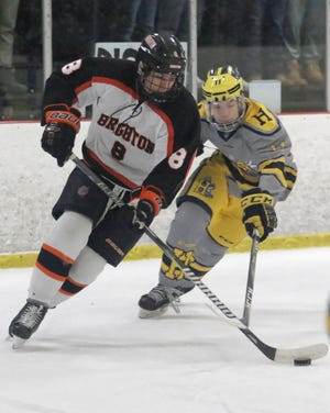 Brighton's Tim Erkkila (8) is a two-time all-state defenseman.