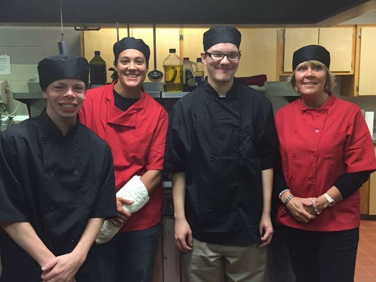 Torch 180 students and founders, from left, Clayton Chenoweth, Sarah Ruddle, Alyxander Stokes and Rhonda Callanan pose during a culinary arts class for people who are disabled at the First United Methodist Church in Brighton.