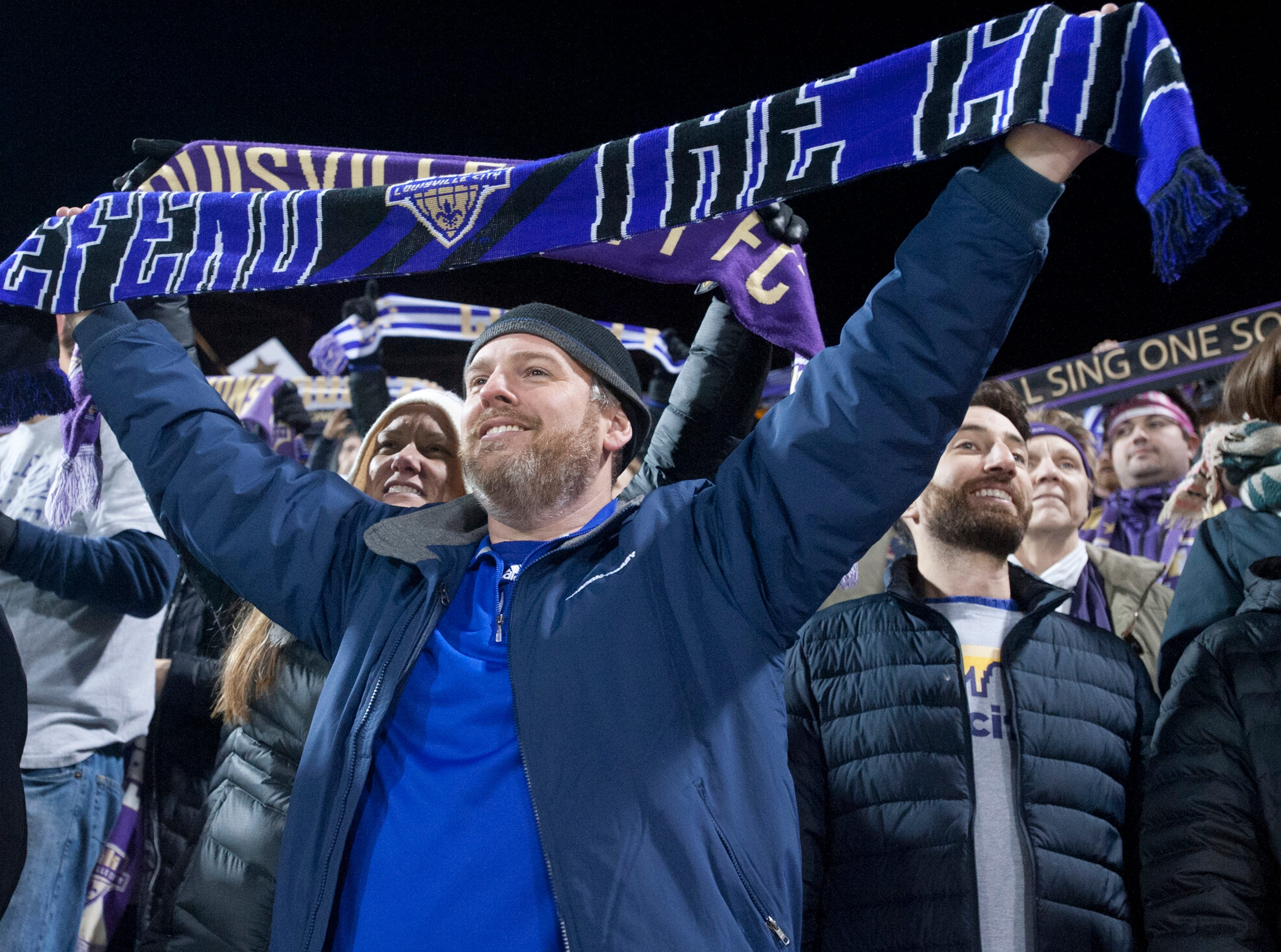 Jess Vowell of Jeffersonton holds up his scarf in support of his team,  Louisville City FC as they take on the Phoenix Rising FC for the 2018 USL Cup.November 08, 2018
