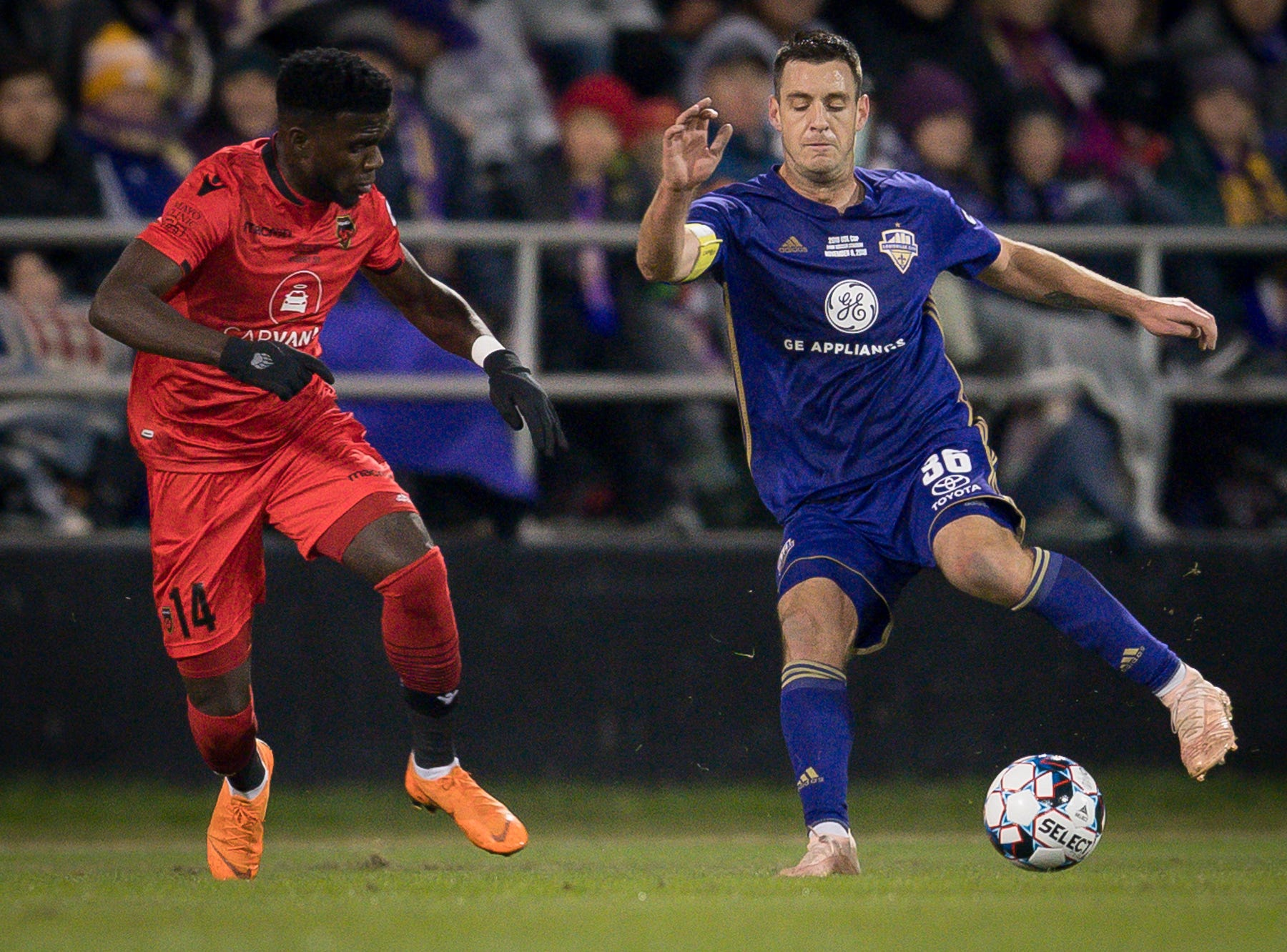 Louisville City FC midfielder Paolo DelPiccolo (36) plays against Phoenix Rising FC forward Jason Johnson (14) during the first half of the USL Cup final played at Lynn Stadium on the campus of the University of Louisville, Louisville, Ky., Thursday, Nov., 8, 2018. (PHOTO Bryan Woolston)